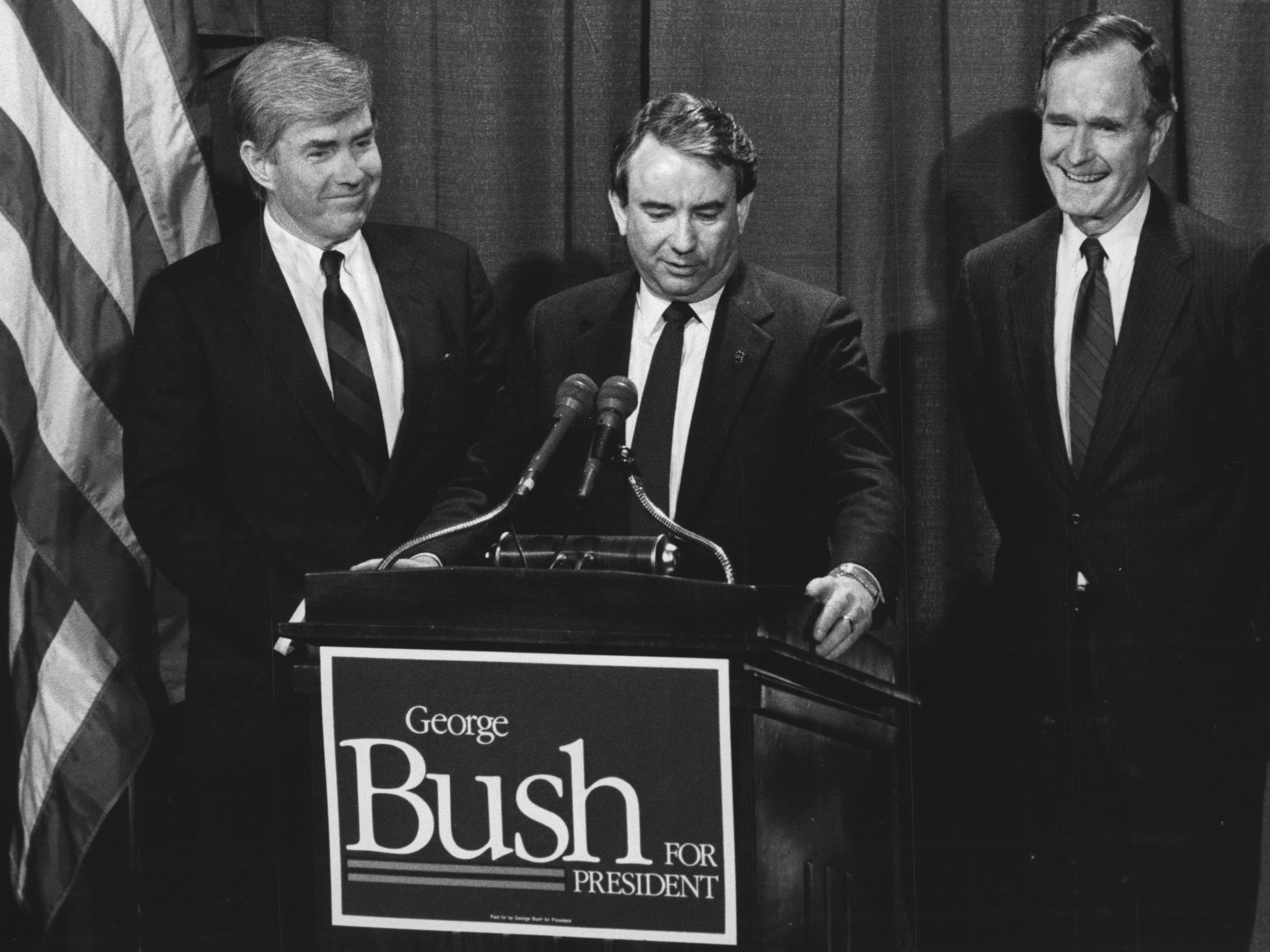 Vice President George Bush (right) smiles along with U.S. Rep. Jack Kemp (left) of New York as they listen to Wisconsin Gov. Tommy Thompson during a joint appearance in 1988 at the Pfister Hotel.