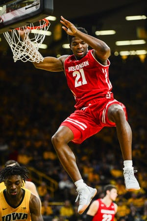 Wisconsin forward Khalil Iverson starts his descent to the court after throwing down a dunk against Iowa on Friday night in Iowa City.