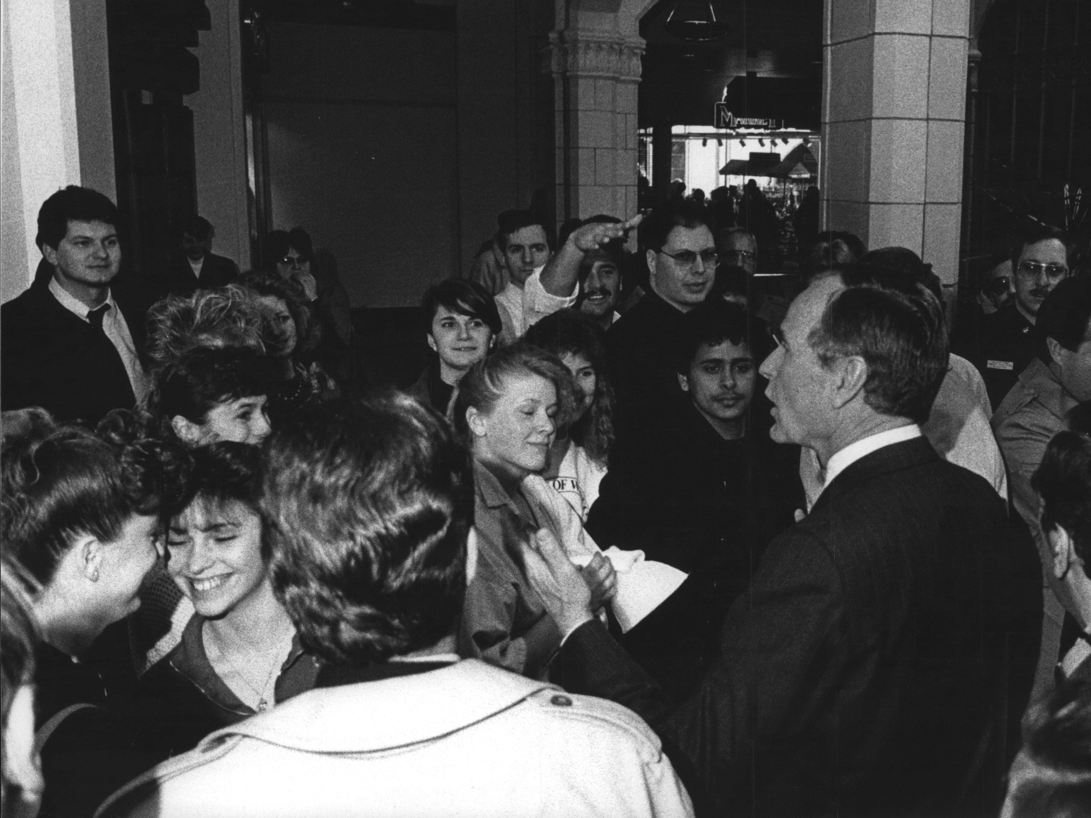 George Bush greet students at Marquette University High School in 1988.
