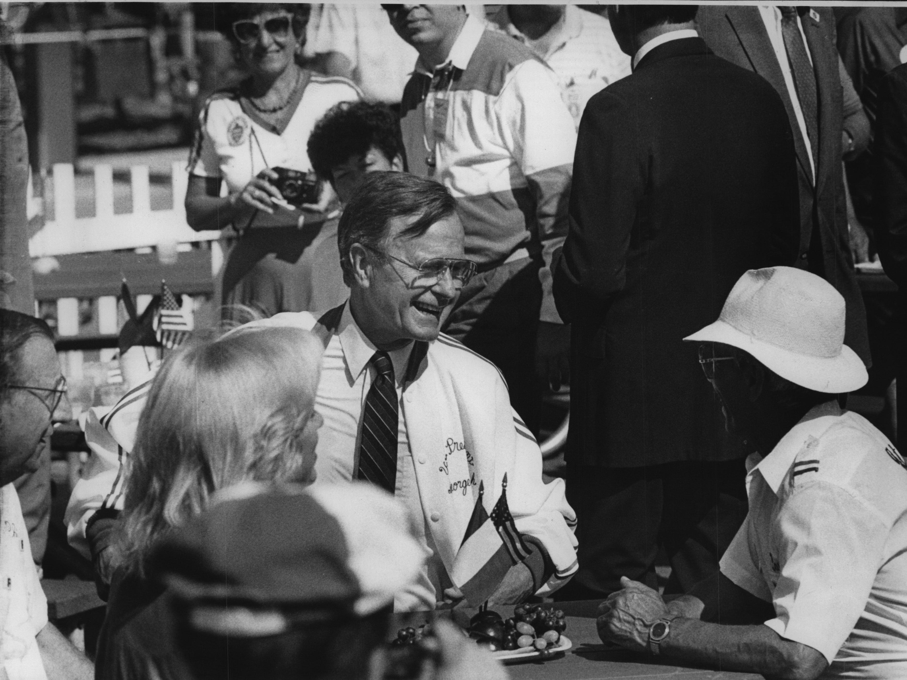 Vice President George Bush chats with visitors to Festa Italiana during a  campaign stop in Milwaukee in 1988.