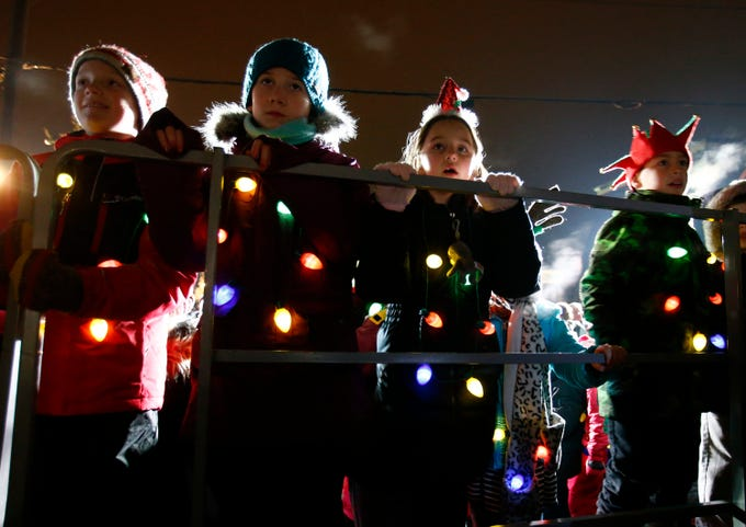 Children choir members turn on risers to watch St. Charles Choir members perform during Hartland Lights on Nov. 30.