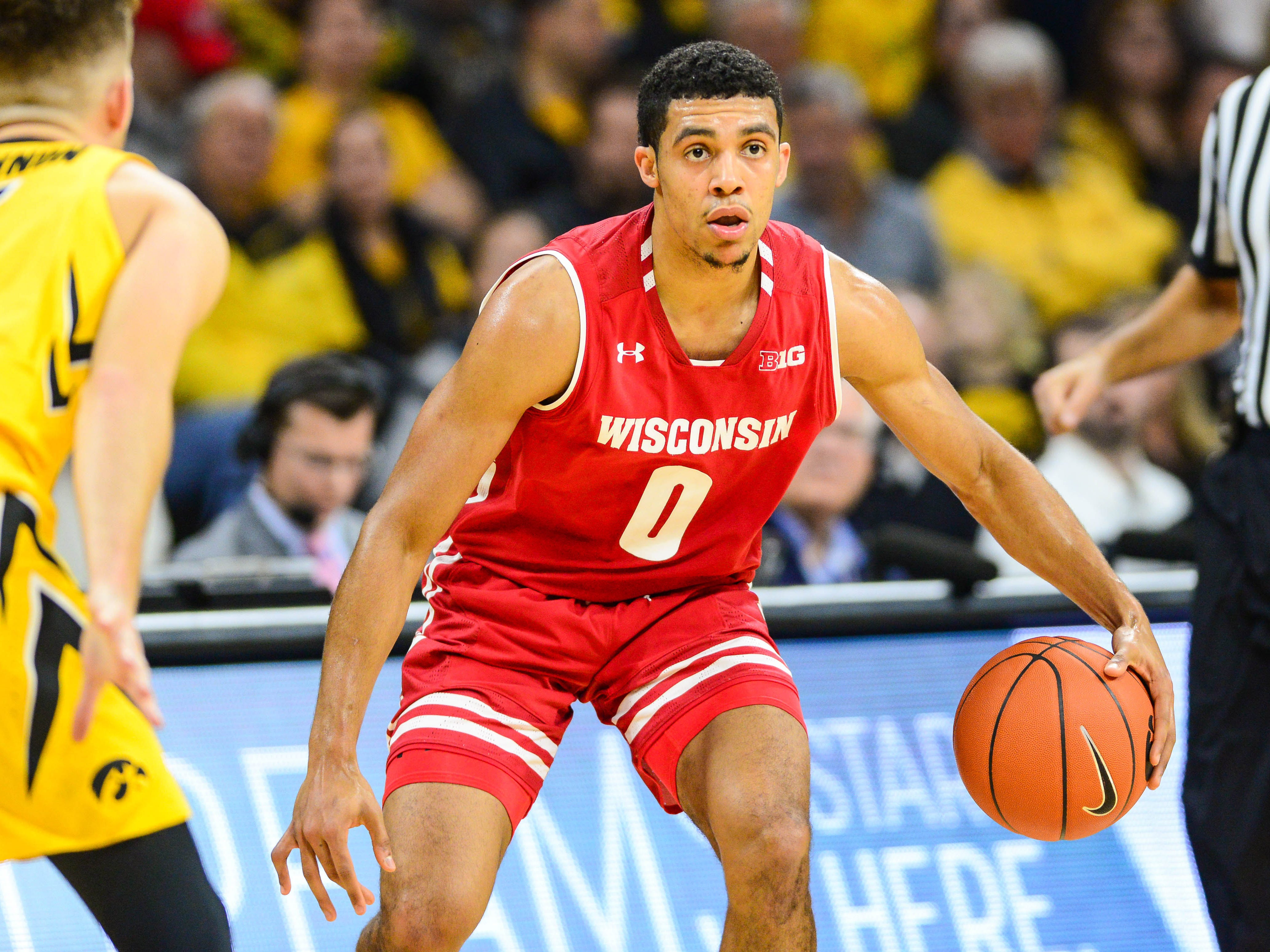 UW point guard D'Mitrik Trice surveys the court during the first half of the Badgers' game against Iowa on Friday night.