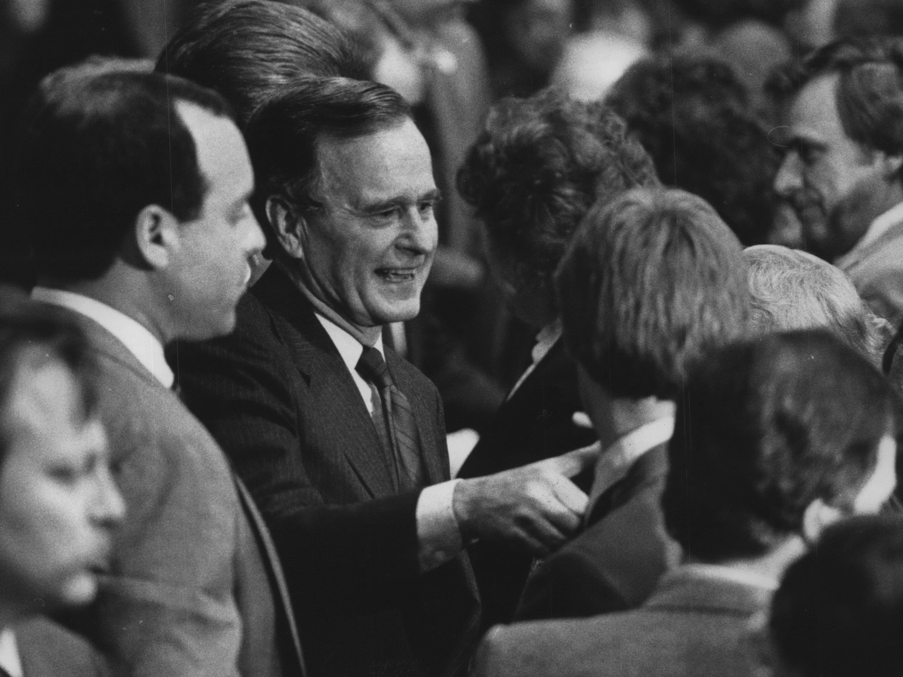Vice President George Bush shakes hands with a crowd of well-wishers after a campaign appearance in 1988 at Cedarburg High School.