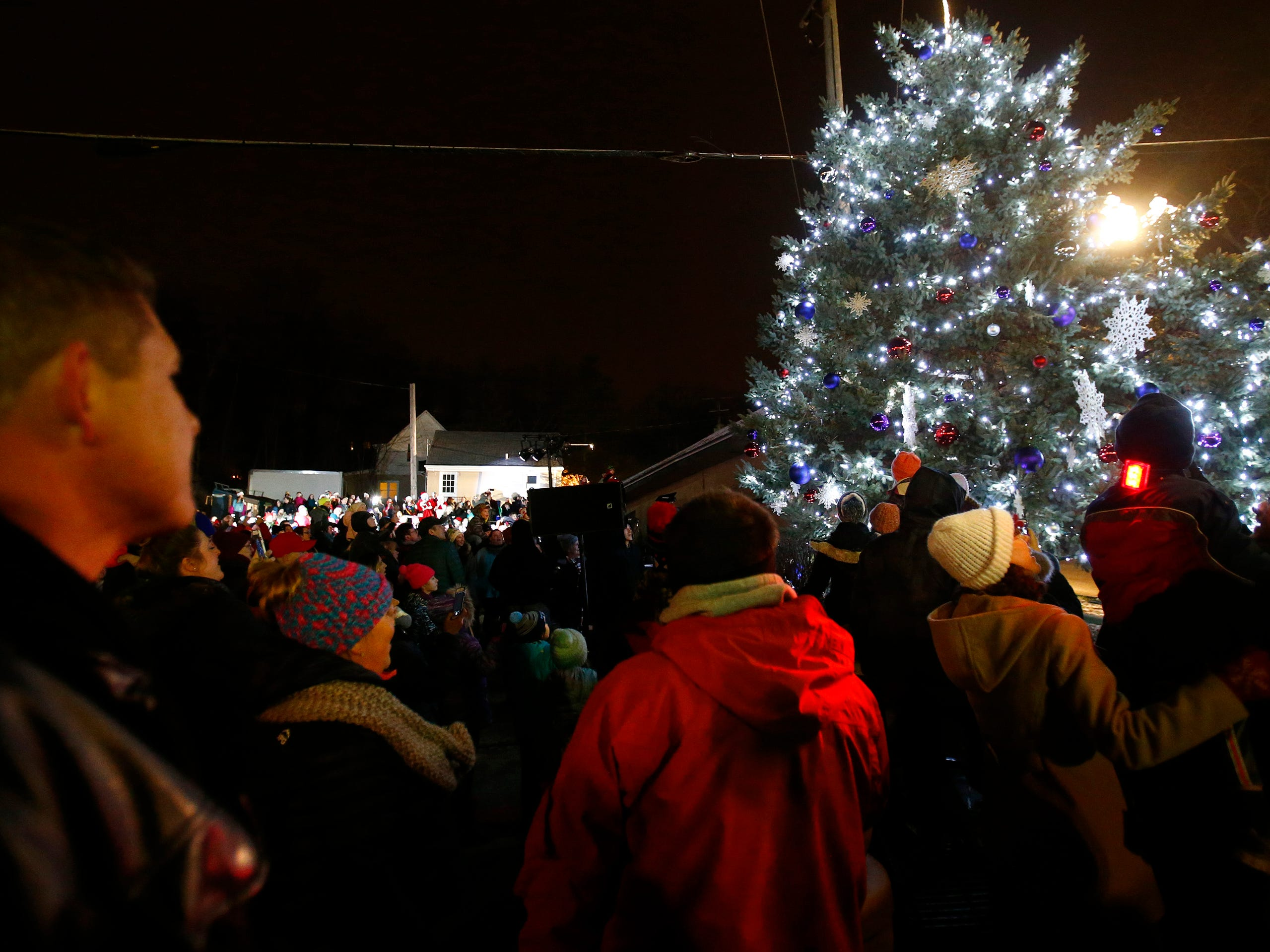 Following choral songs and a countdown by the crowd, the Village's Christmas tree is illuminated during Hartland Lights on Nov. 30.