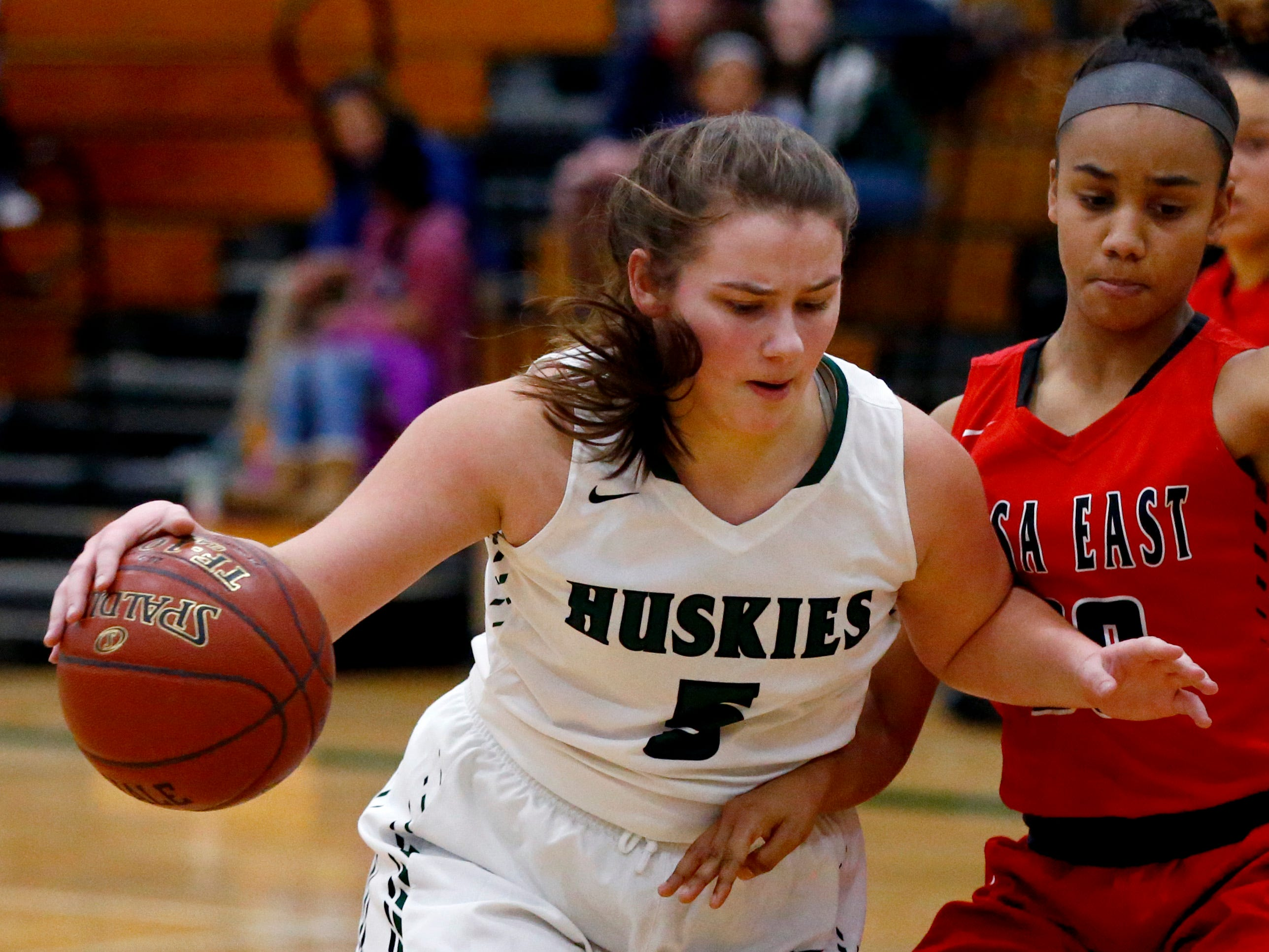 West Allis Hale's Olivia McLure drives past Wauwatosa East's Natalie Land at Hale on Nov. 30.