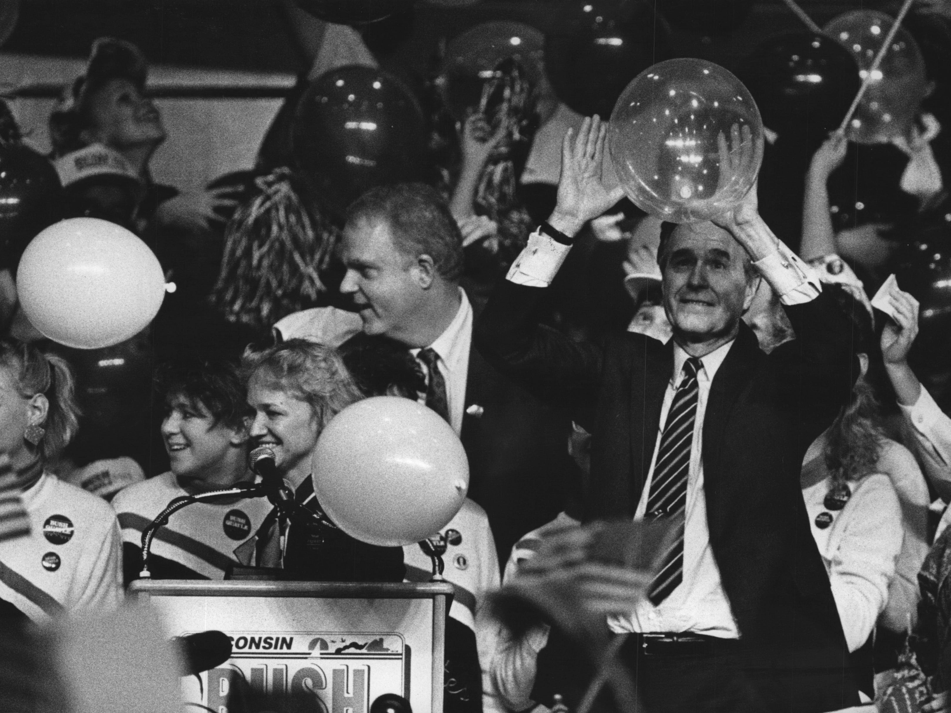Flags were waving and overflow crowds were chanting as Vice President George Bush brought his presidential campaign to the Waukesha County Exposition Center in 1988. Republican presidential nominee George Bush batted a balloon around after hundreds of them fell.