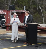 Joan Vickers (left) reads some brief comments about the new Marion County Law Enforcement Center on Friday afternoon. Joan Vickers is the widow of Marion County Sheriff Rogers Vickers, who died in office in 2015. Joan Vickers was appointed to complete her late husband's term in office, serving until Jan. 1, 2017.