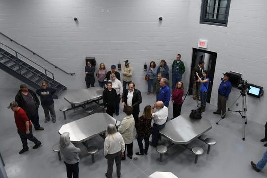 Visitors walk through the new Marion County Law Enforcement Center on Friday afternoon.