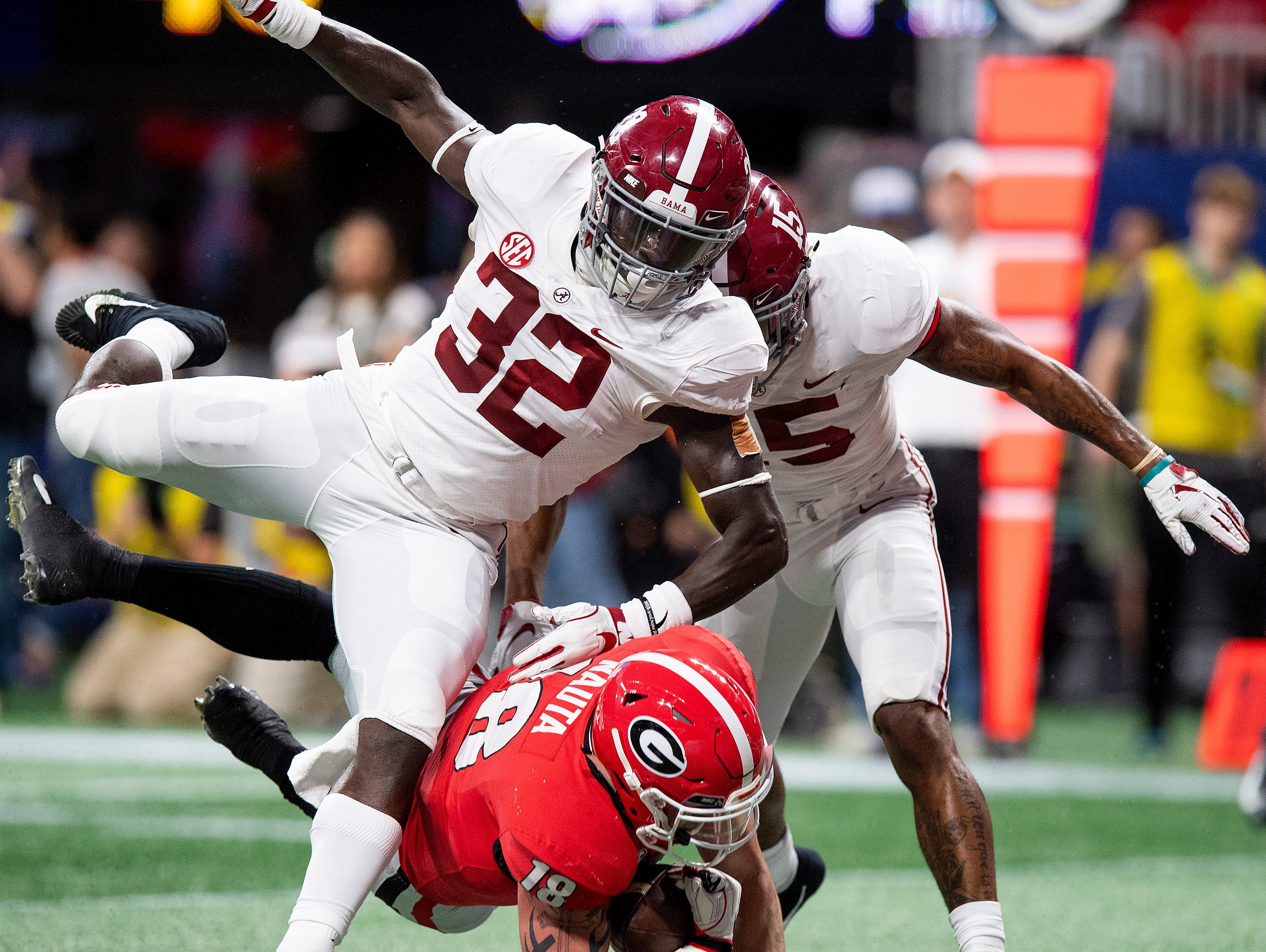 Georgia tight end Isaac Nauta (18) catches a pass for a touchdown against Alabama linebacker Dylan Moses (32) and defensive back Xavier McKinney (15) during first half action of the SEC Championship Game at Mercedes Benz Stadium in Atlanta, Ga., on Saturday December 1, 2018.