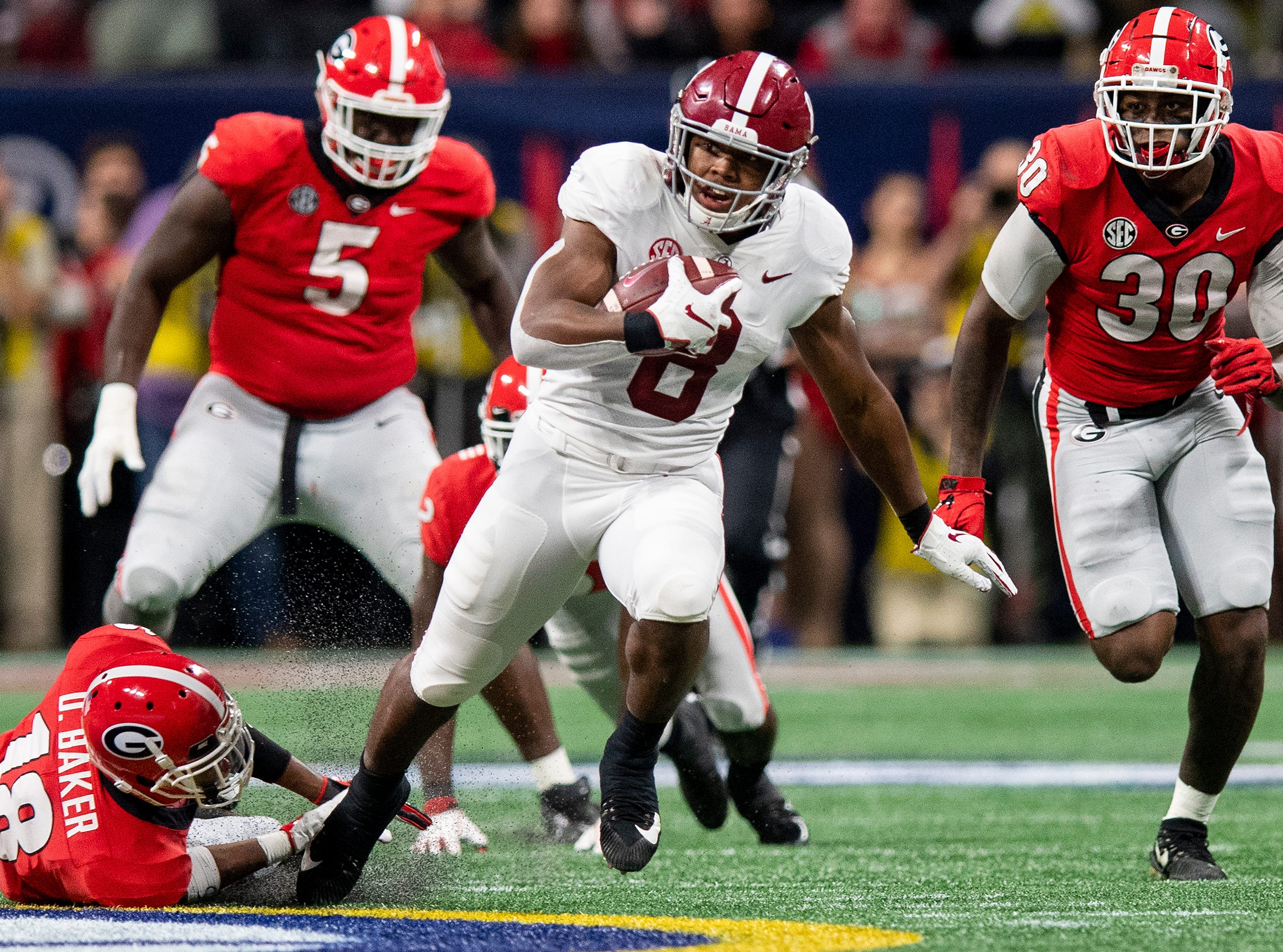 Alabama running back Josh Jacobs (8) breaks free fo big yardage against Georgia during first half action of the SEC Championship Game at Mercedes Benz Stadium in Atlanta, Ga., on Saturday December 1, 2018.