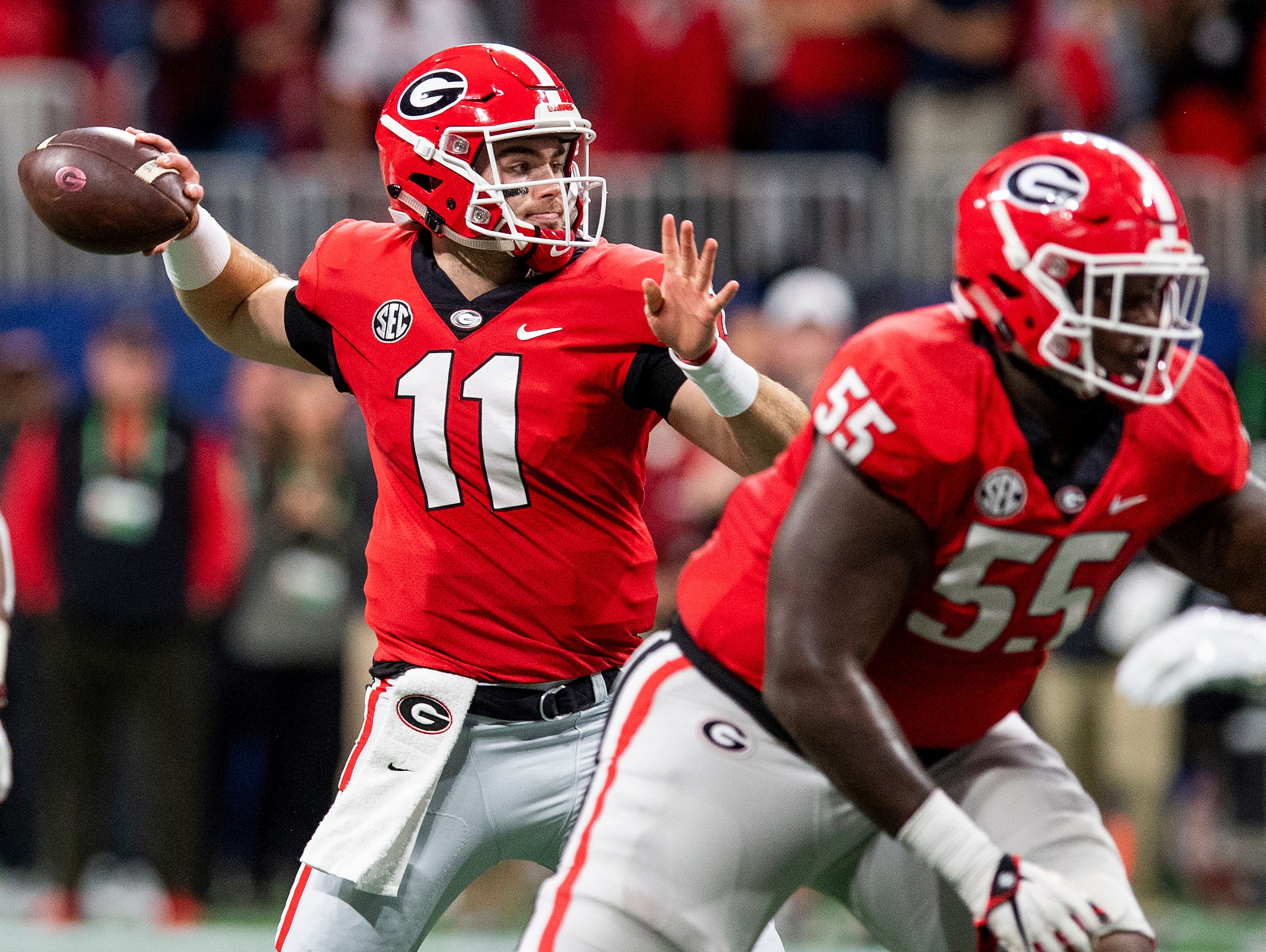 Georgia quarterback Jake Fromm (11) passes against Alabama during first half action of the SEC Championship Game at Mercedes Benz Stadium in Atlanta, Ga., on Saturday December 1, 2018.