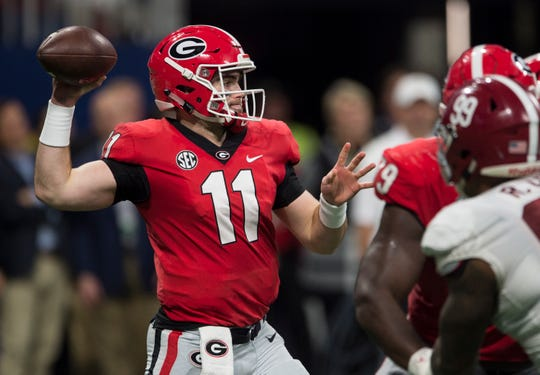 Georgia quarterback Jake Fromm (11) throws the ball down field during the SEC Championship game at Mercedes-Benz Stadium in Atlanta, Ga., on Saturday Dec. 1, 2018. Georgia leads Alabama 21-14 at halftime.