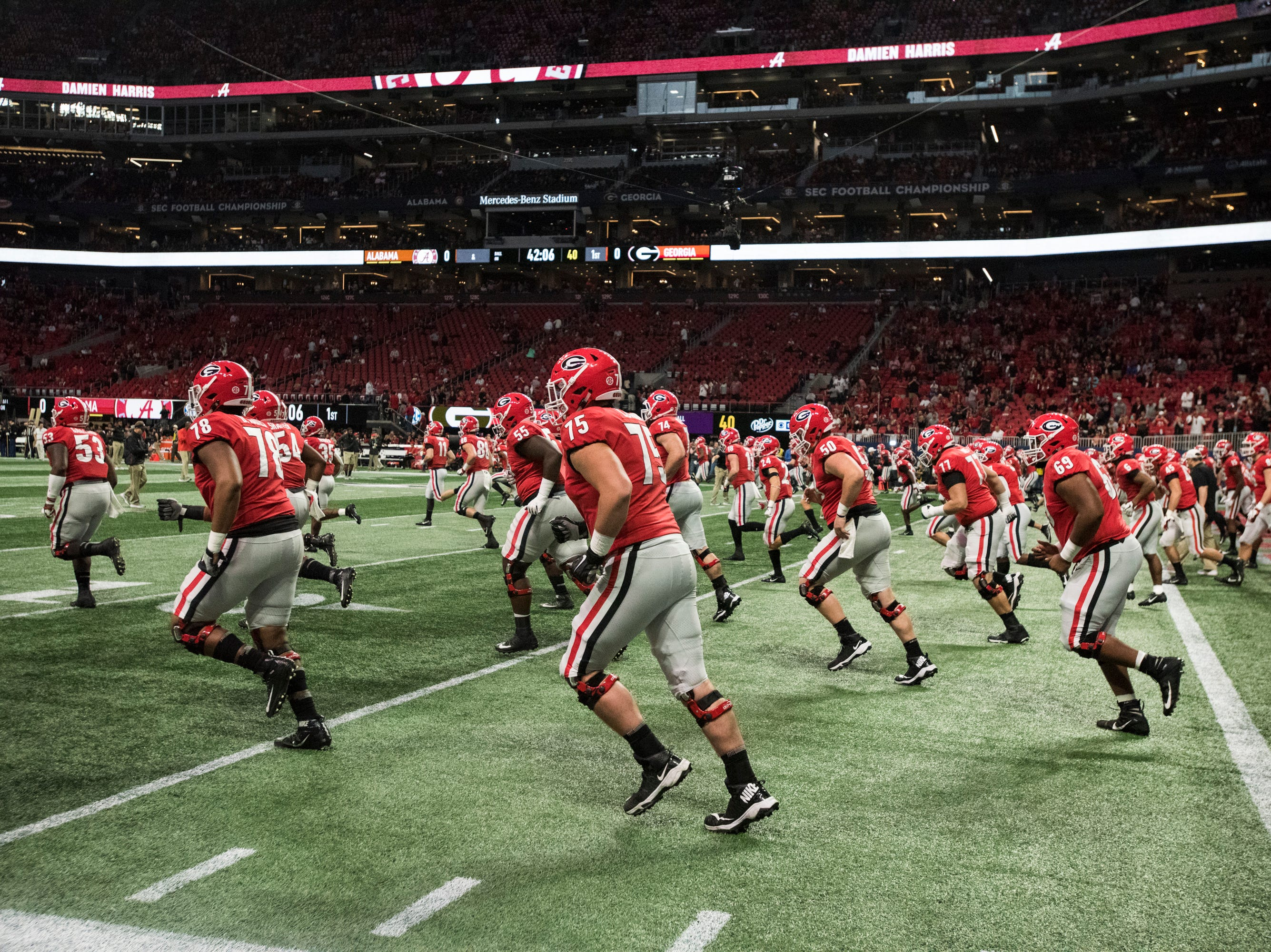 Georgia players warm up before the SEC Championship game at Mercedes-Benz Stadium in Atlanta, Ga., on Saturday Dec. 1, 2018.