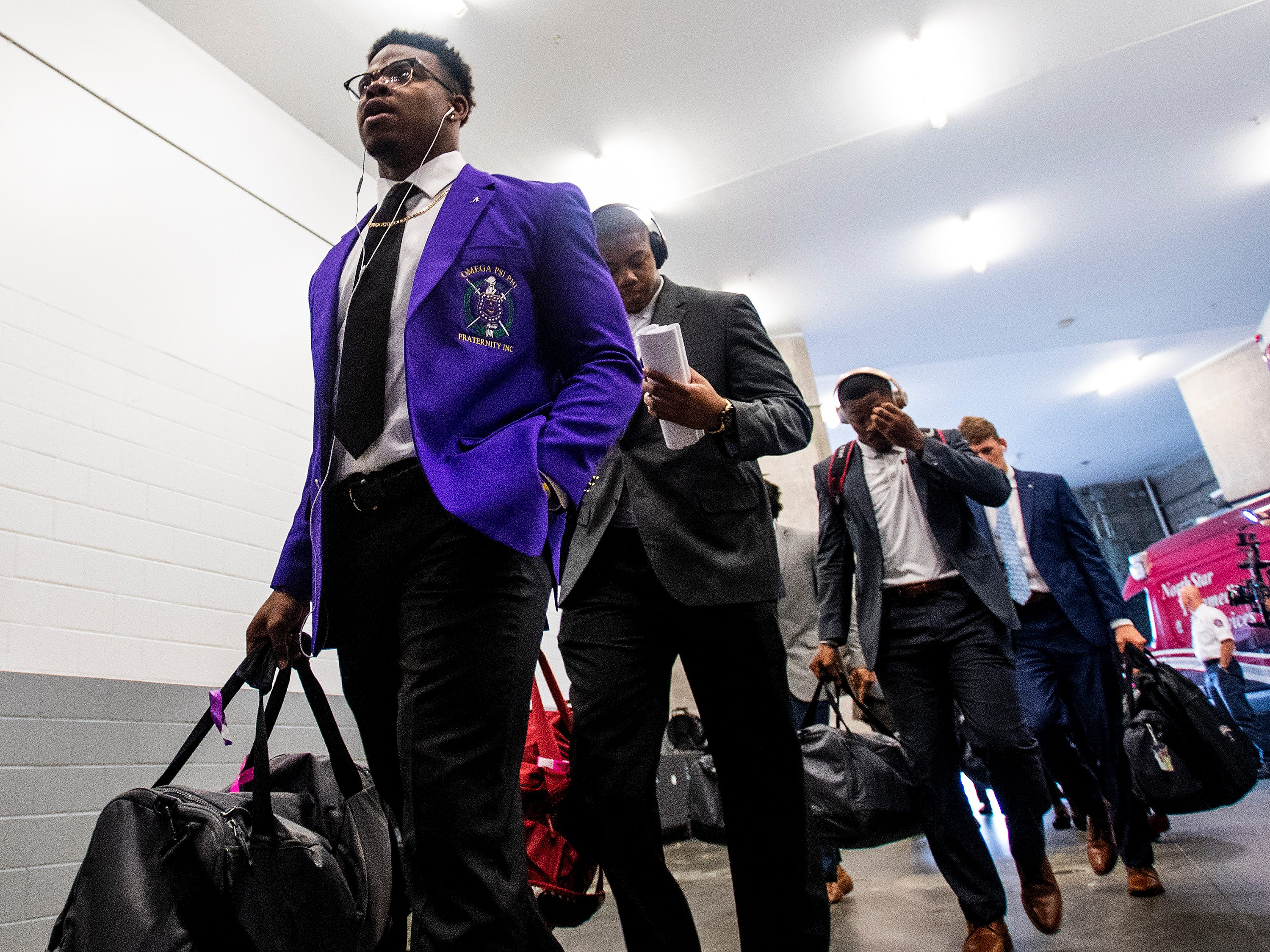 Alabama running back Damien Harris (34) arrives with the team before the SEC Championship Game at Mercedes Benz Stadium in Atlanta, Ga., on Saturday December 1, 2018.
