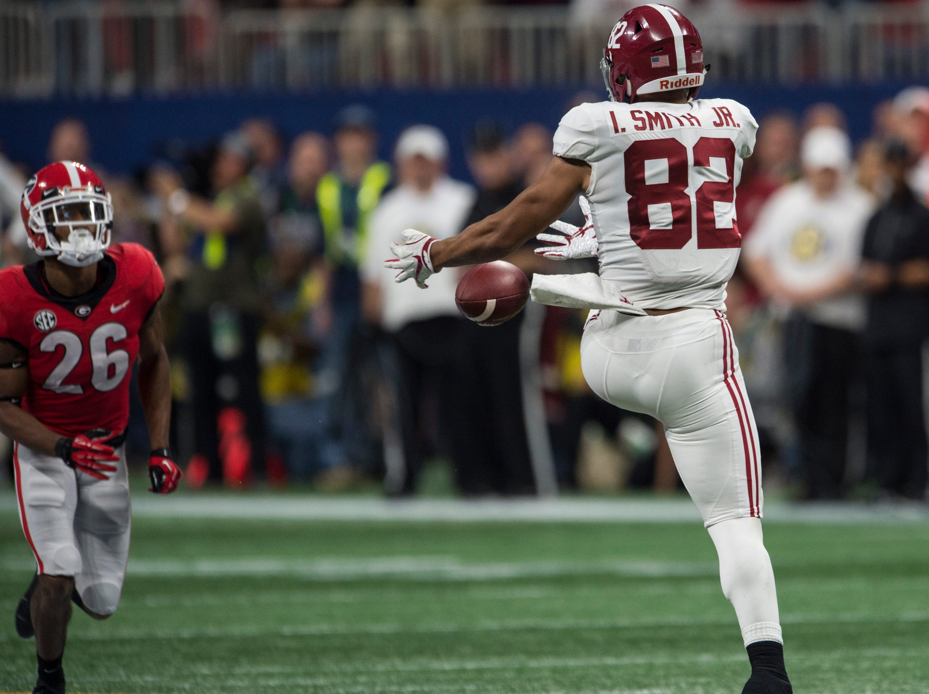 Alabama tight end Irv Smith Jr. (82) drops an open pass during the SEC Championship game at Mercedes-Benz Stadium in Atlanta, Ga., on Saturday Dec. 1, 2018. Georgia leads Alabama 21-14 at halftime.