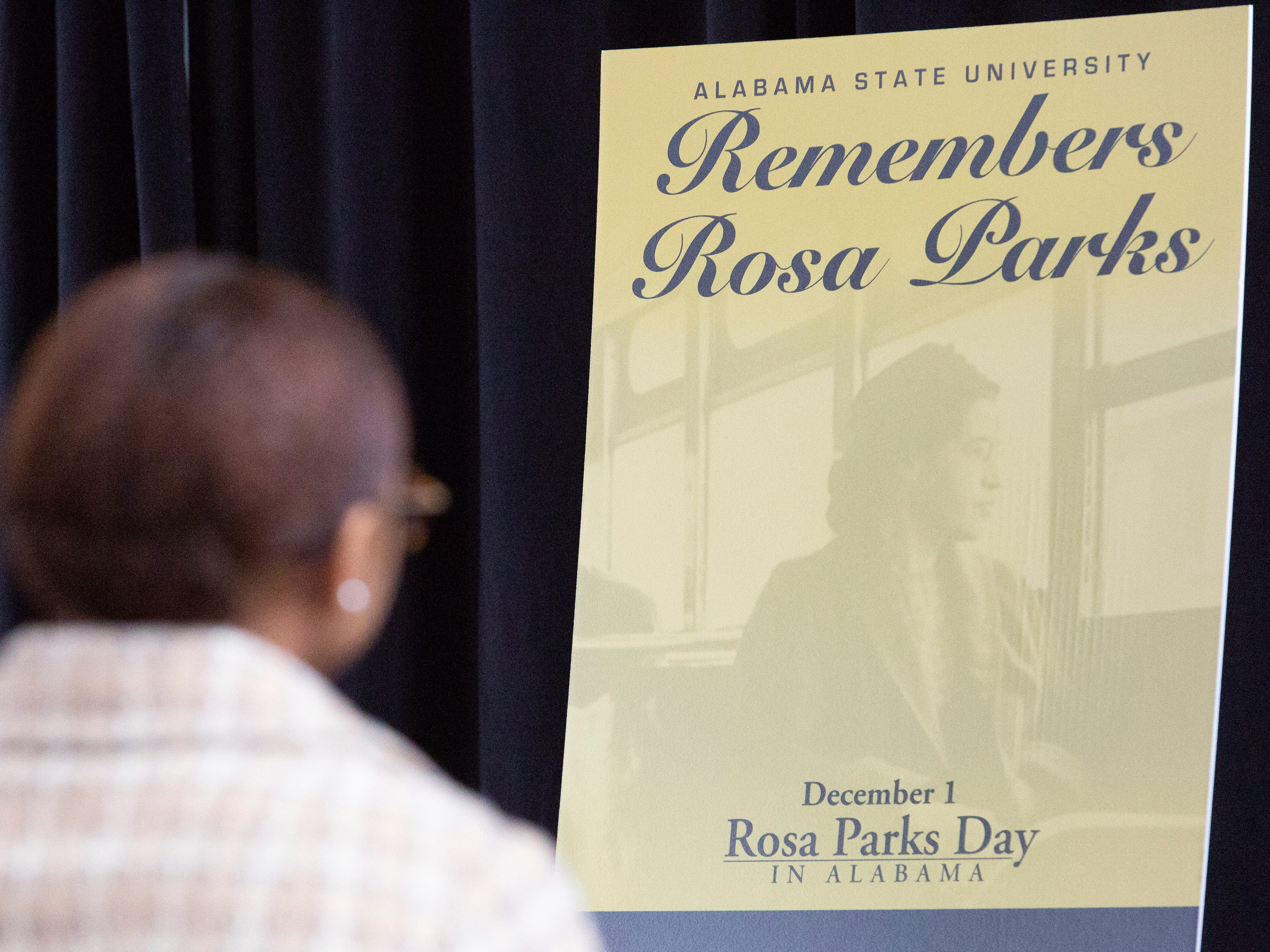"Kortney Coleman, portraying Rosa Parks, sits in reverence during an event honoring the ""mother of the movement."""