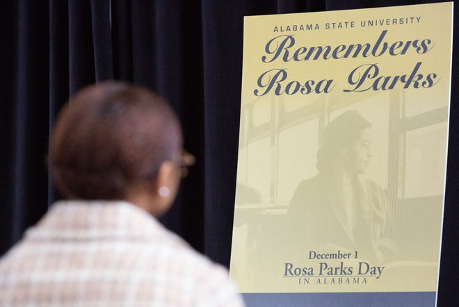 """Kortney Coleman, portraying Rosa Parks, sits in reverence during an event honoring the """"mother of the movement."""""""