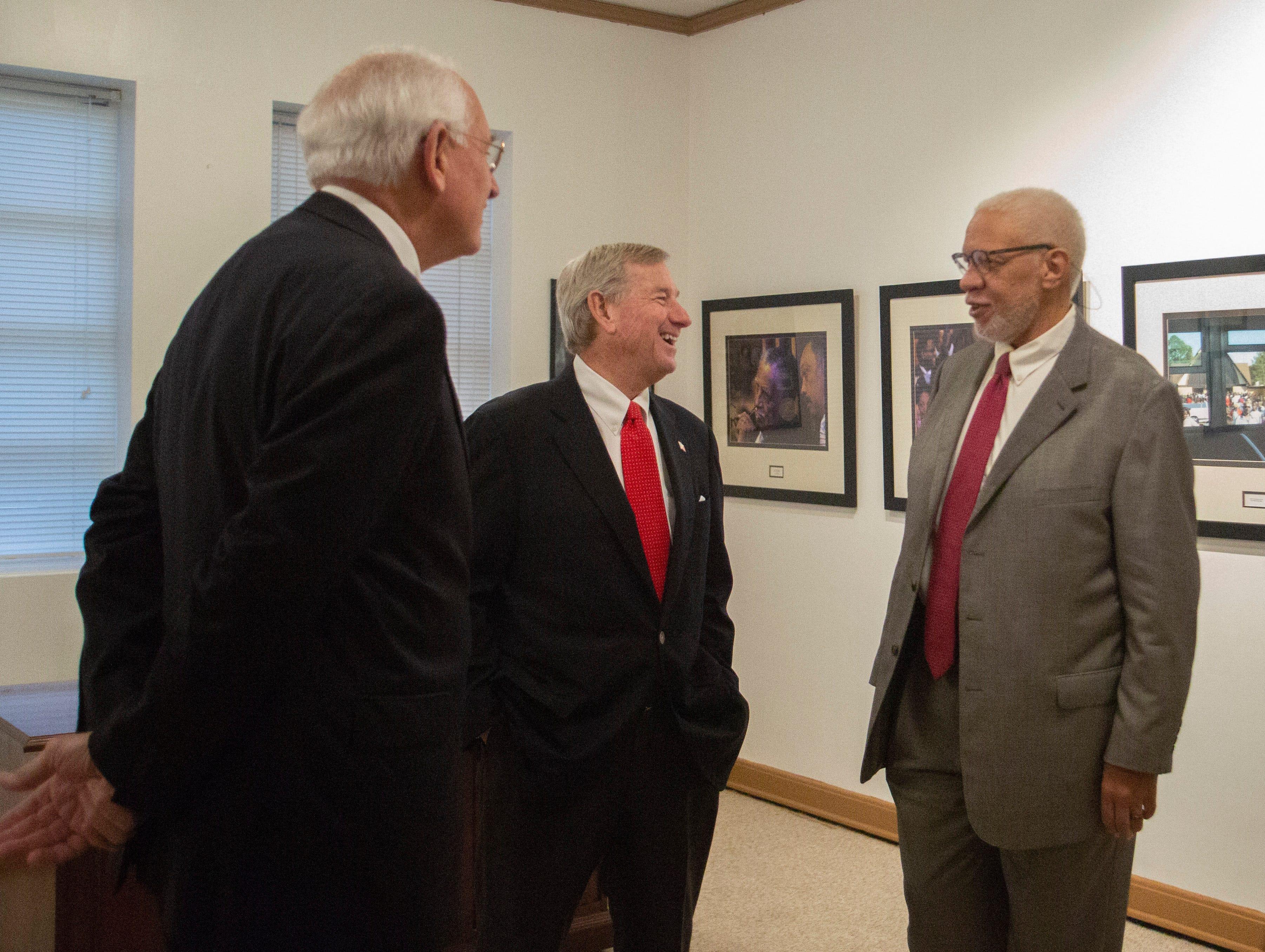 Montgomery Mayor Todd Strange talks with Lamar Higgins, a lobbyist who helped push legislation to designate a Rosa Parks Day.