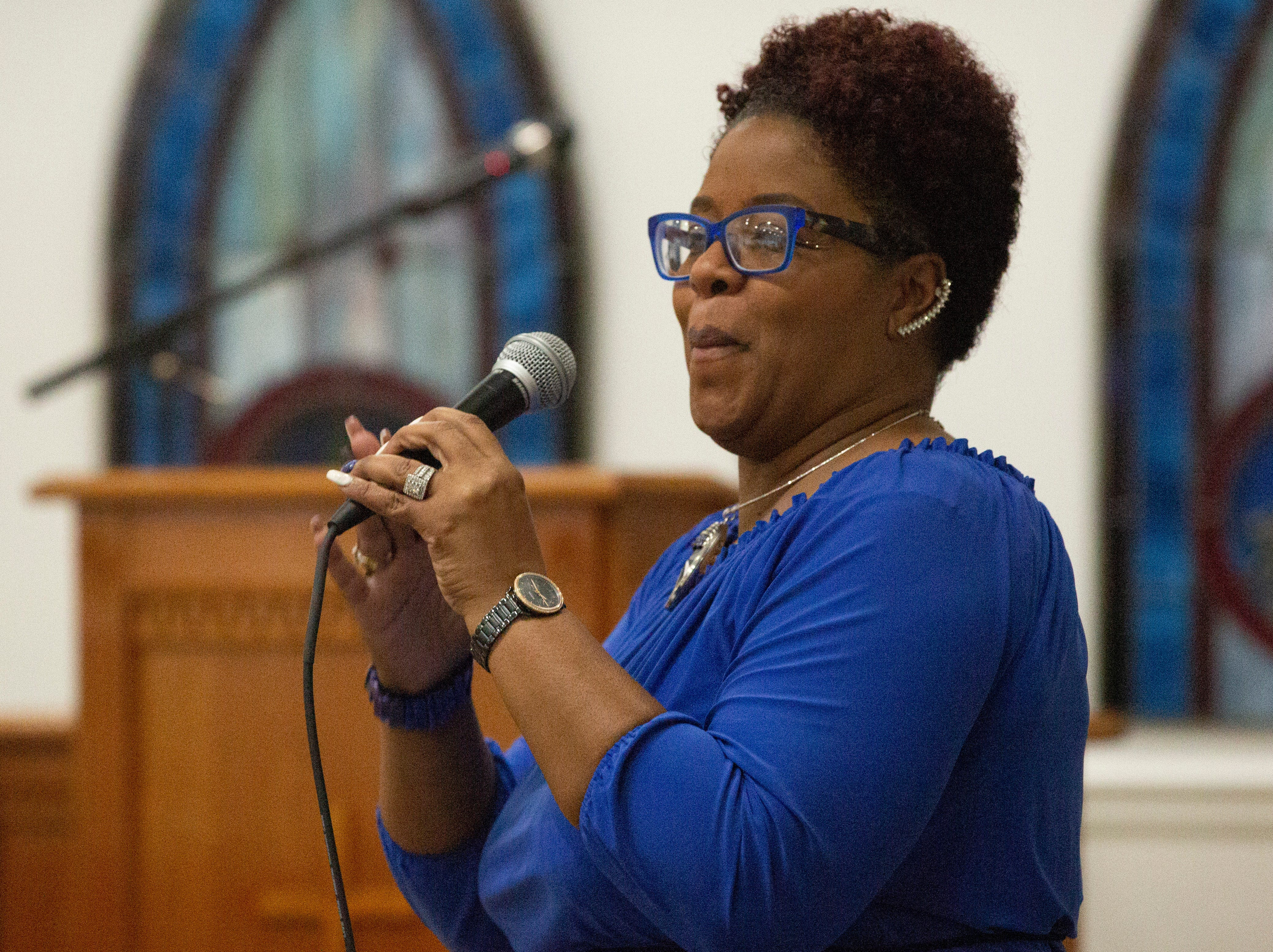 Rev. Lynntesha Henley leads attendees in song during the unity breakfast.