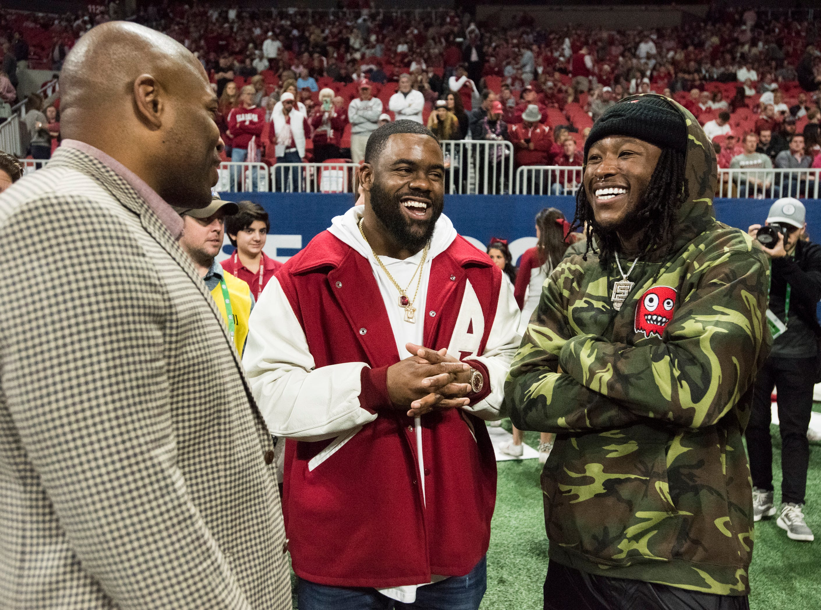 Former Alabama running backs Shaun Alexander, Mark Ingram and Alvin Kamara chat on the sidelines during warm ups before the SEC Championship game at Mercedes-Benz Stadium in Atlanta, Ga., on Saturday Dec. 1, 2018.