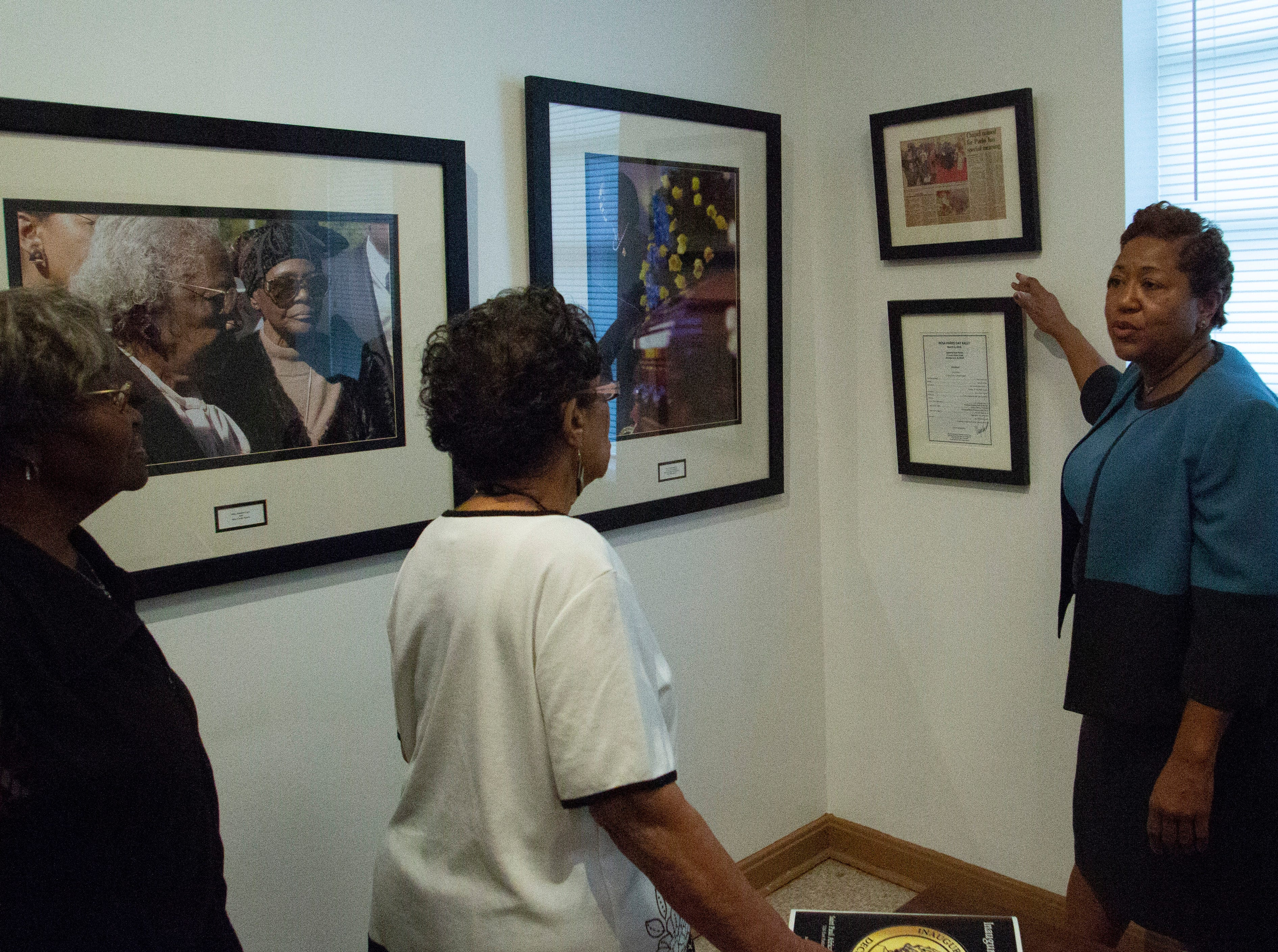Rev. Agnes Lover gives a tour of St. Paul AME Church where photos of Parks' memorial service line the hallways.
