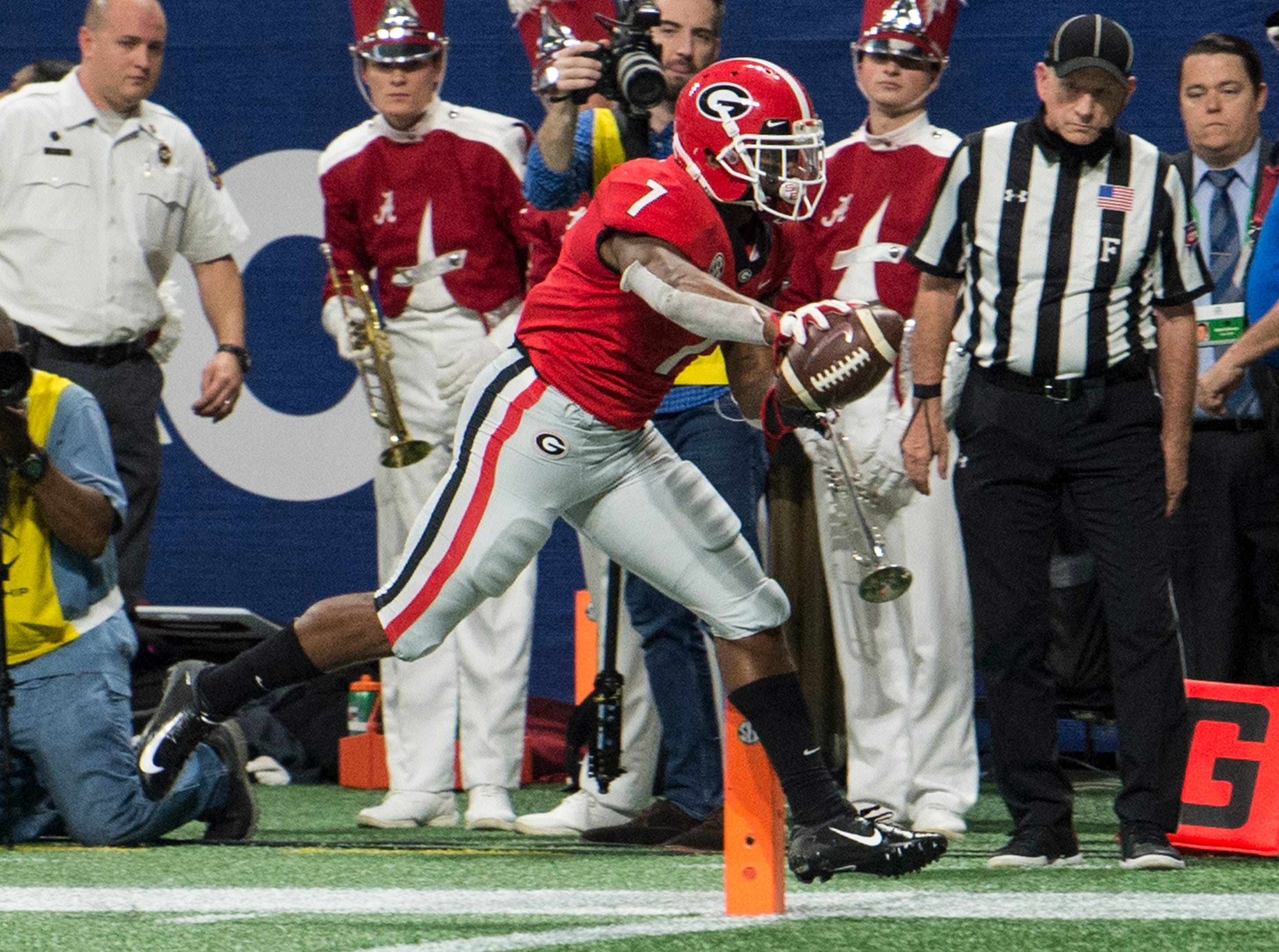 Georgia running back D'Andre Swift (7) runs into the end zone for a touchdown during the SEC Championship game at Mercedes-Benz Stadium in Atlanta, Ga., on Saturday Dec. 1, 2018. Georgia leads Alabama 21-14 at halftime.