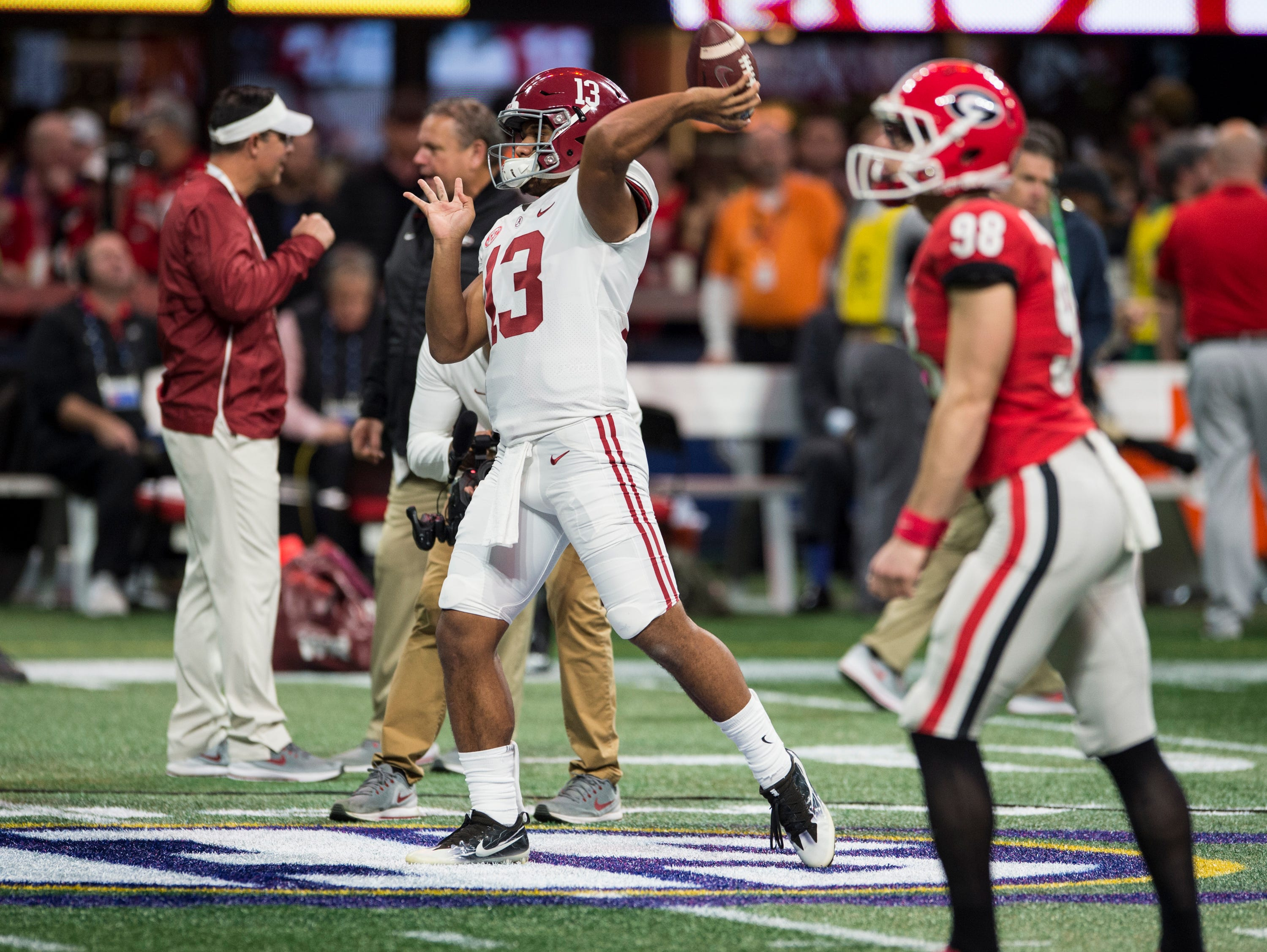 Alabama quarterback Tua Tagovailoa (13) and Georgia kicker Rodrigo Blankenship (98) warm up before the SEC Championship game at Mercedes-Benz Stadium in Atlanta, Ga., on Saturday Dec. 1, 2018.
