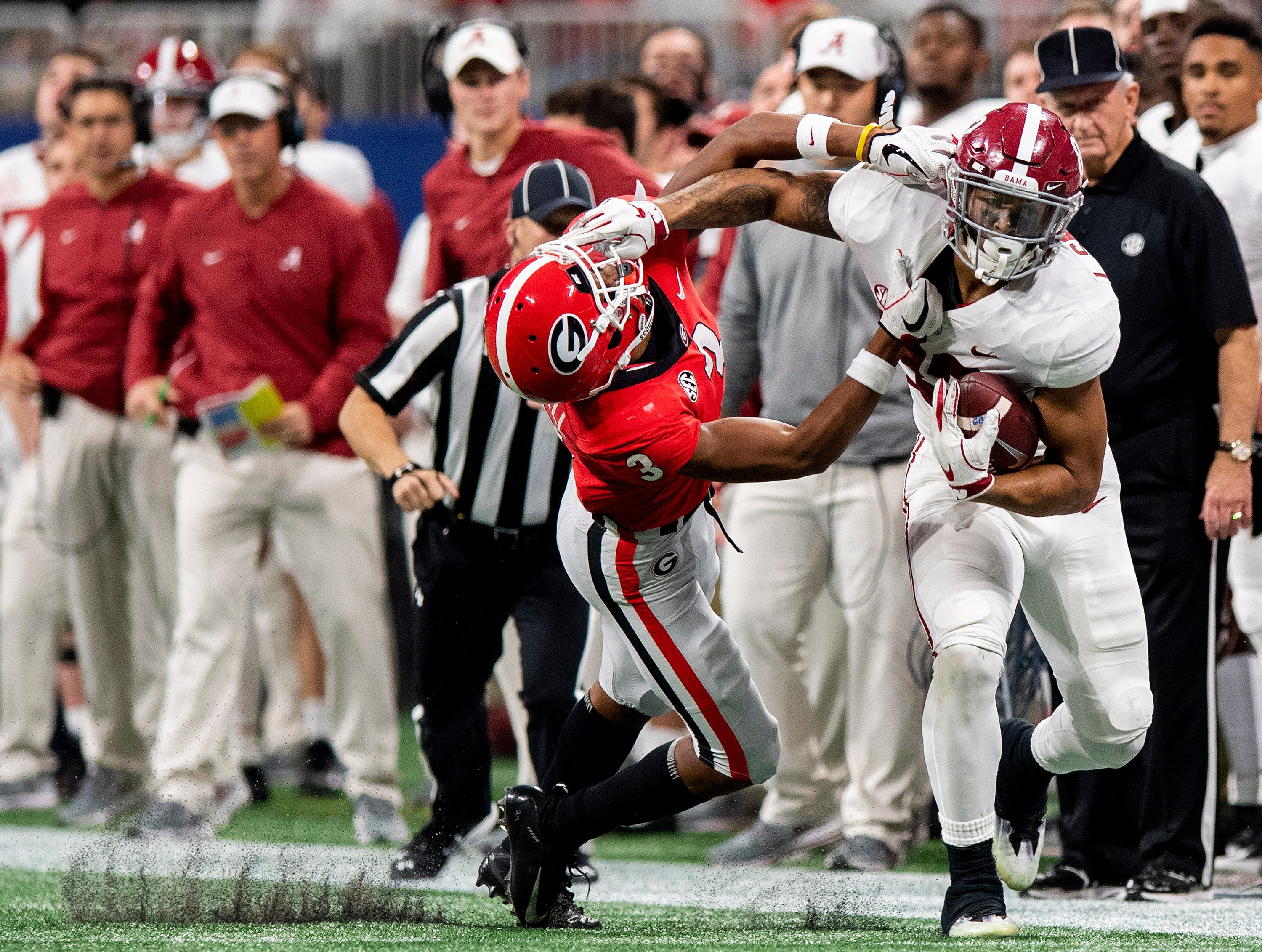Alabama tight end Irv Smith Jr. (82) fights off the tackle of Georgia defensive back Tyson Campbell (3) during first half action of the SEC Championship Game at Mercedes Benz Stadium in Atlanta, Ga., on Saturday December 1, 2018.