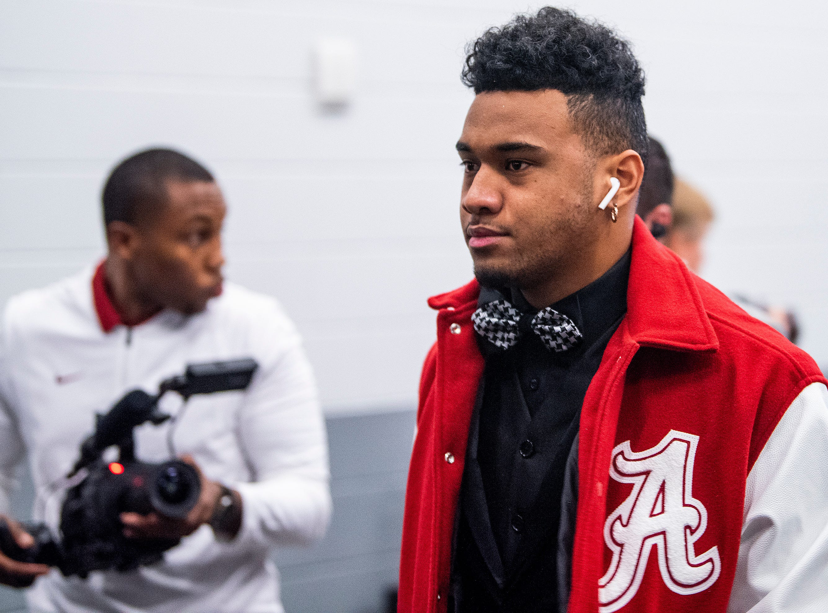 Alabama quarterback Tua Tagovailoa (13) arrives with the team before the SEC Championship Game at Mercedes Benz Stadium in Atlanta, Ga., on Saturday December 1, 2018.