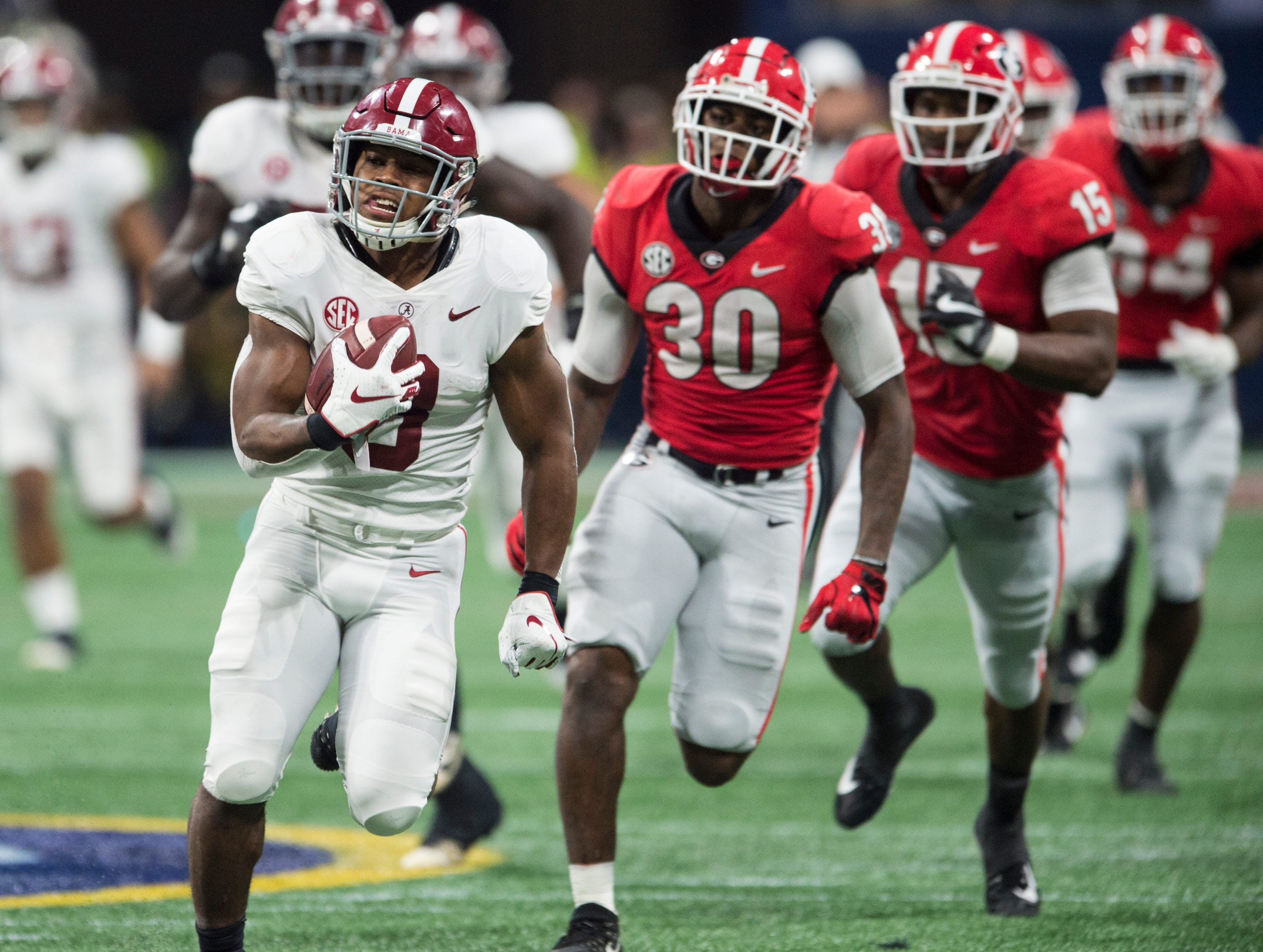 Alabama running back Josh Jacobs (8) breaks a big run during the SEC Championship game at Mercedes-Benz Stadium in Atlanta, Ga., on Saturday Dec. 1, 2018. Georgia leads Alabama 21-14 at halftime.
