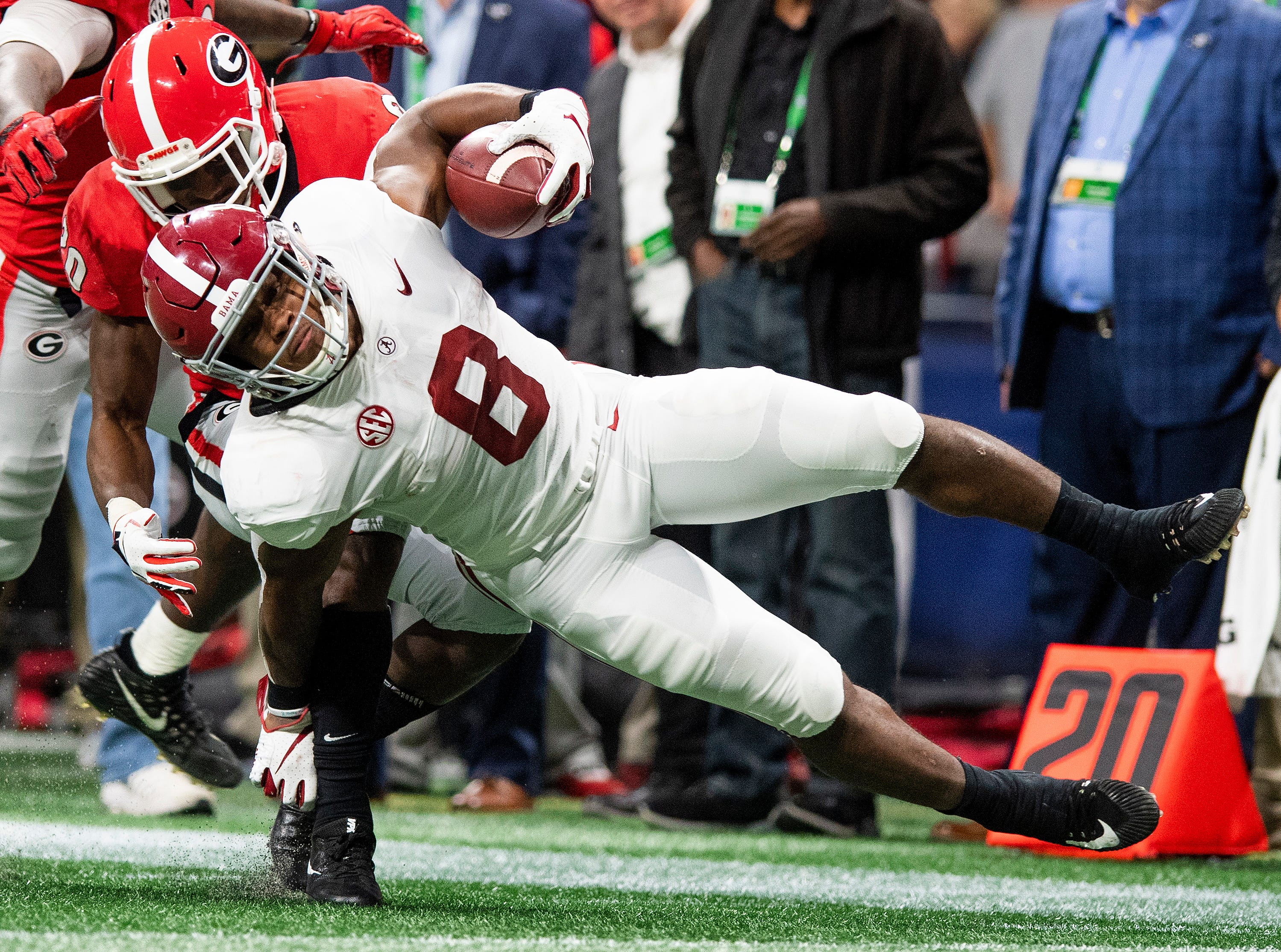 Georgia defensive back J.R. Reed (20) tackles Alabama running back Josh Jacobs (8) after a long gain during first half action of the SEC Championship Game at Mercedes Benz Stadium in Atlanta, Ga., on Saturday December 1, 2018.