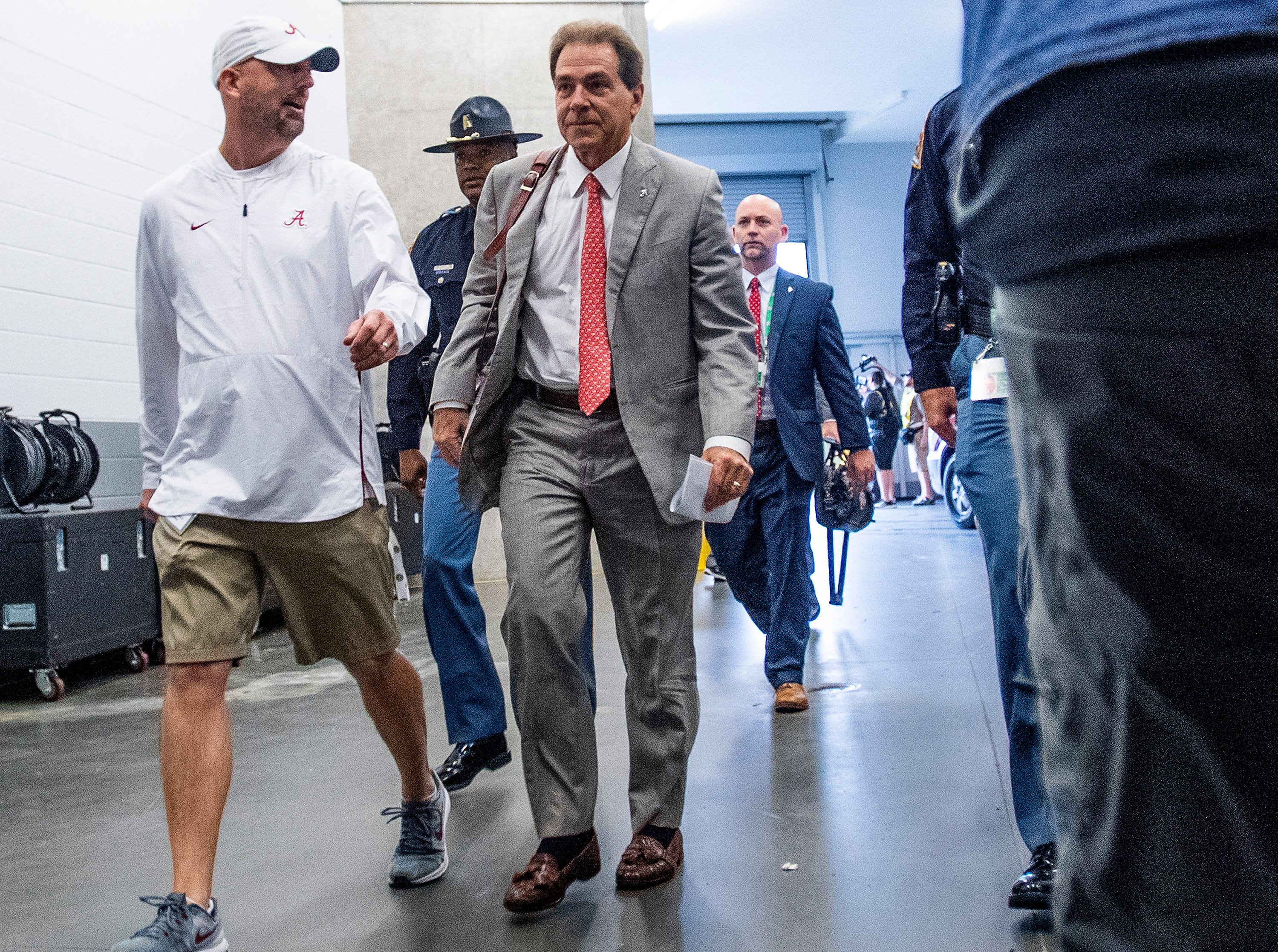 Alabama head coach Nick Saban arrives with the team before the SEC Championship Game at Mercedes Benz Stadium in Atlanta, Ga., on Saturday December 1, 2018.