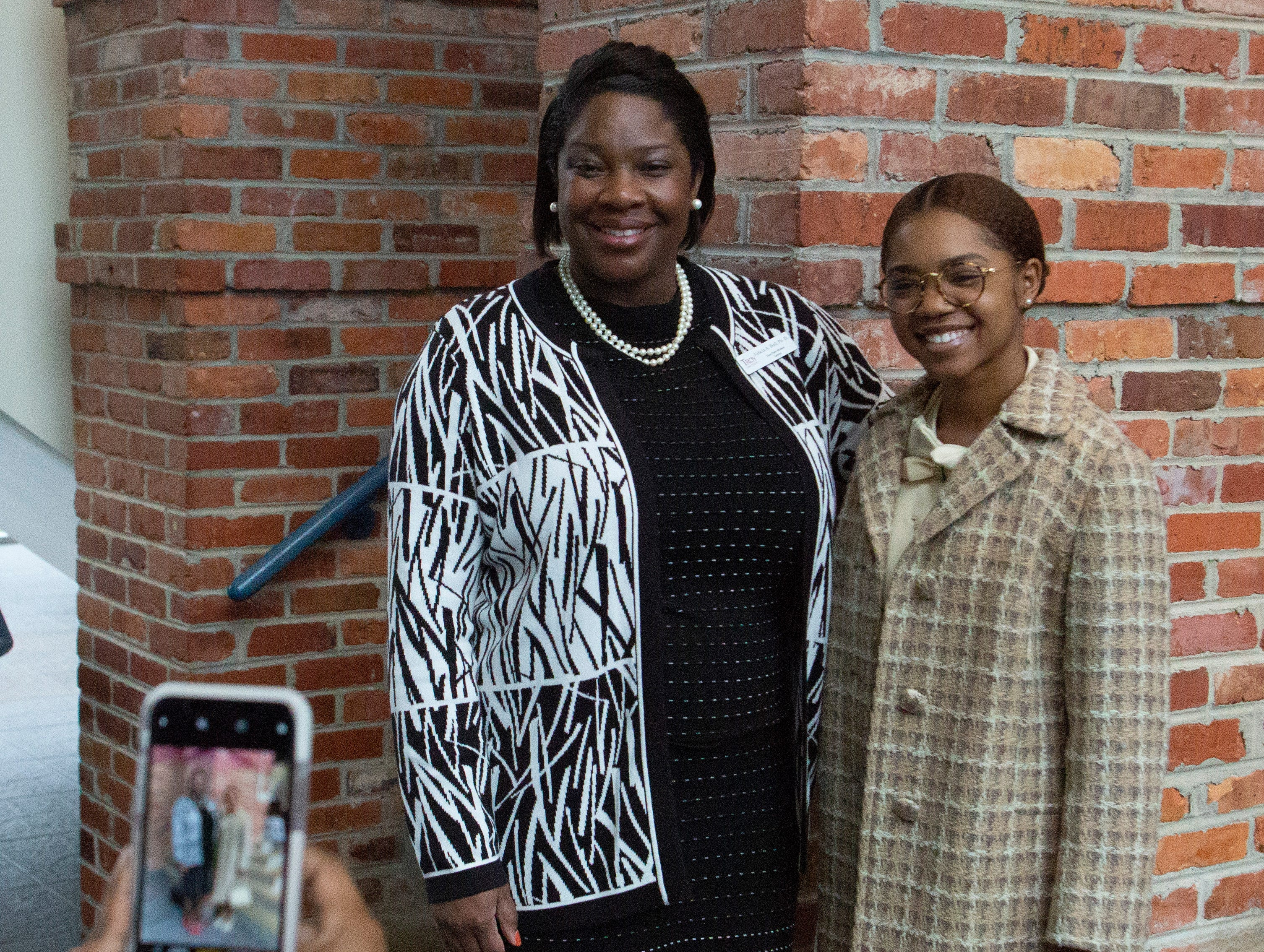Felicia Bell poses for a photo with Kortney Coleman following a Rosa Parks Day event.