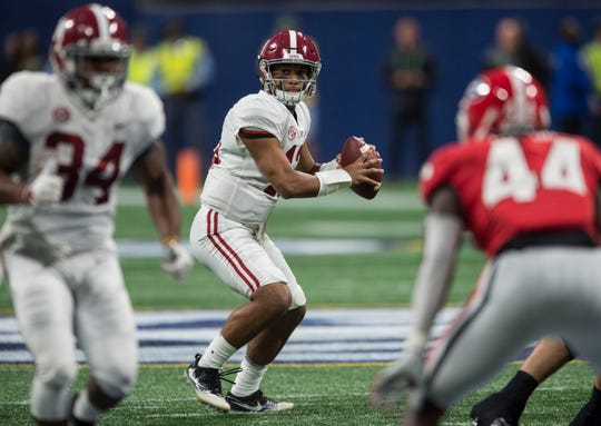 Alabama quarterback Tua Tagovailoa (13) looks to make a pass during the SEC Championship game at Mercedes-Benz Stadium in Atlanta, Ga., on Saturday Dec. 1, 2018. Georgia leads Alabama 21-14 at halftime.
