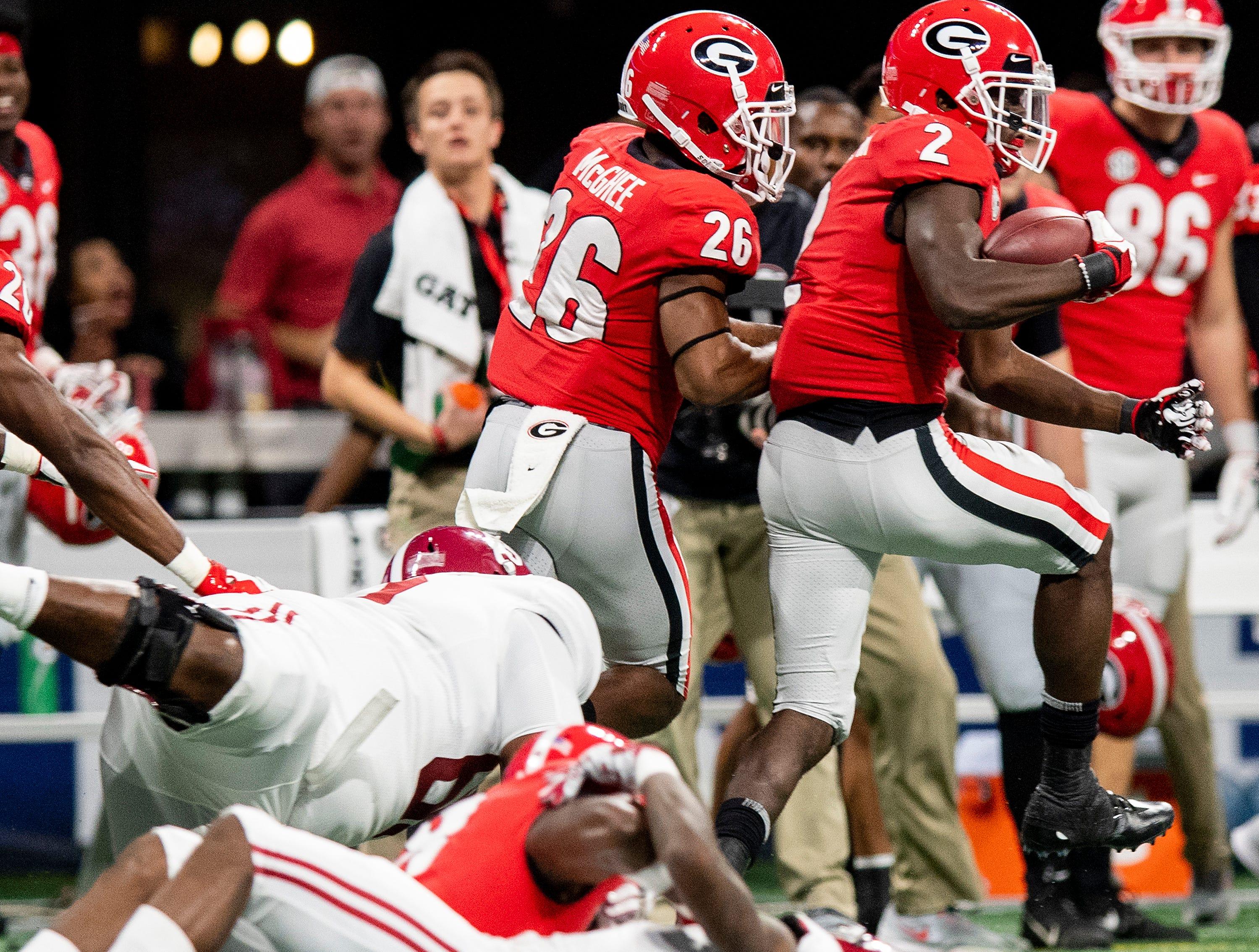 Georgia defensive back Richard LeCounte (2) returns an interception against Alabama during first half action of the SEC Championship Game at Mercedes Benz Stadium in Atlanta, Ga., on Saturday December 1, 2018.