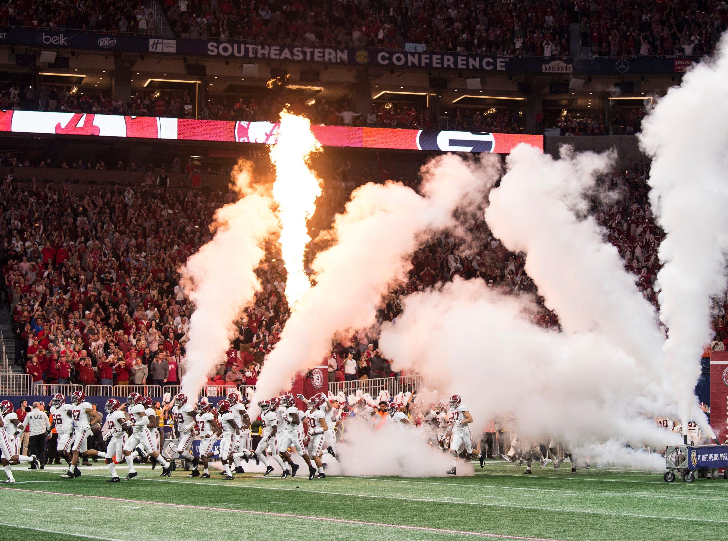 Alabama's team runs onto the field during the SEC Championship game at Mercedes-Benz Stadium in Atlanta, Ga., on Saturday Dec. 1, 2018. Georgia leads Alabama 21-14 at halftime.