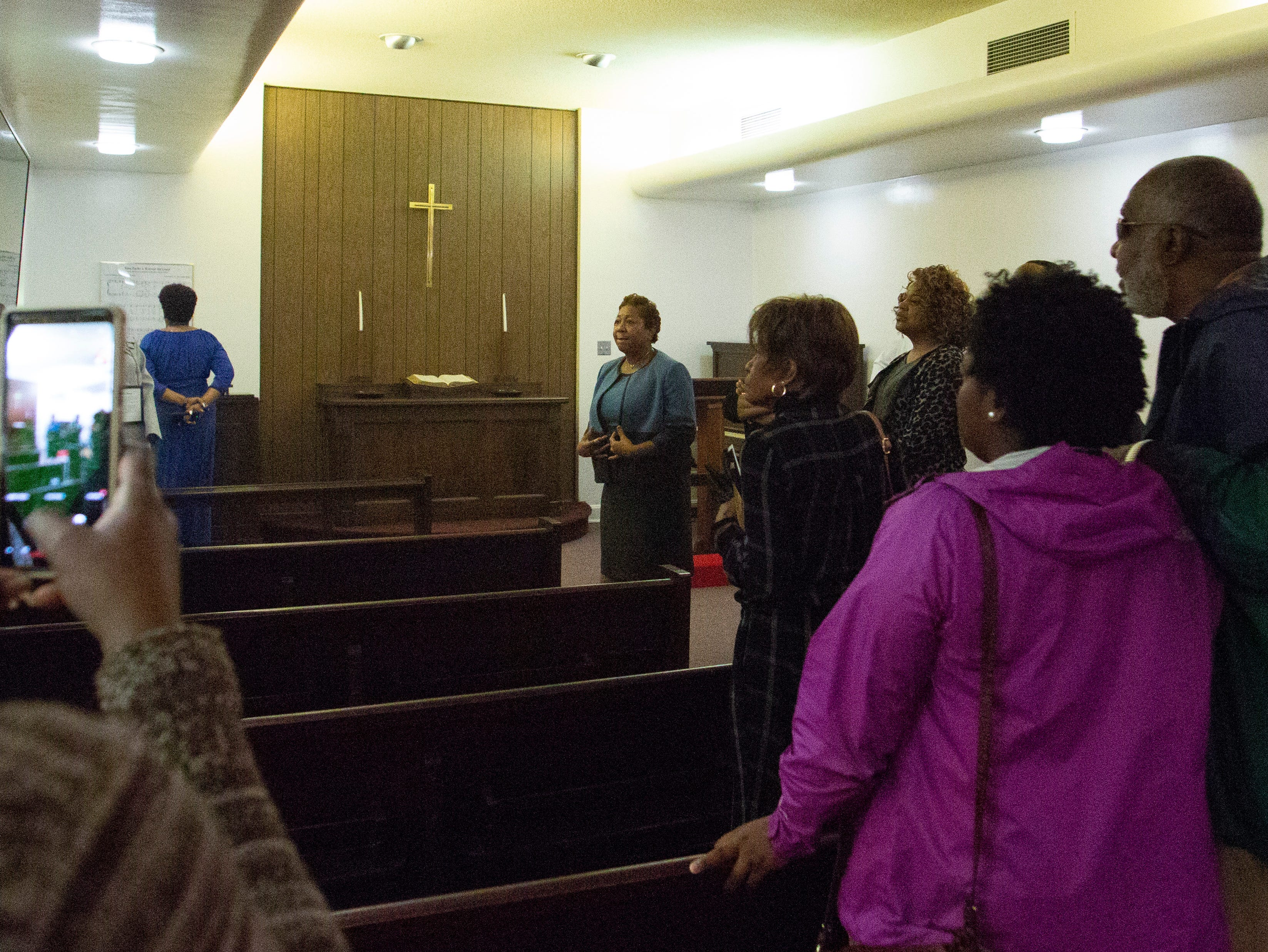 Rev. Agnes Lover gives a tour of the Rosa Parks Chapel at St. Paul AME Church.