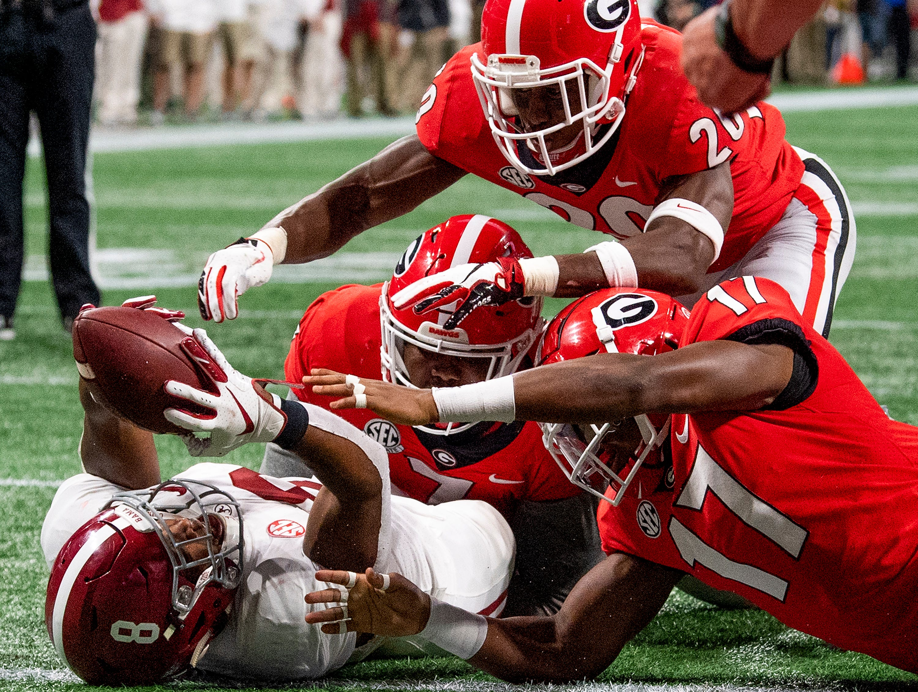 Alabama running back Josh Jacobs (8) recovers an Alabama fumble in the end zone for a touchdown against Georgia during first half action of the SEC Championship Game at Mercedes Benz Stadium in Atlanta, Ga., on Saturday December 1, 2018.