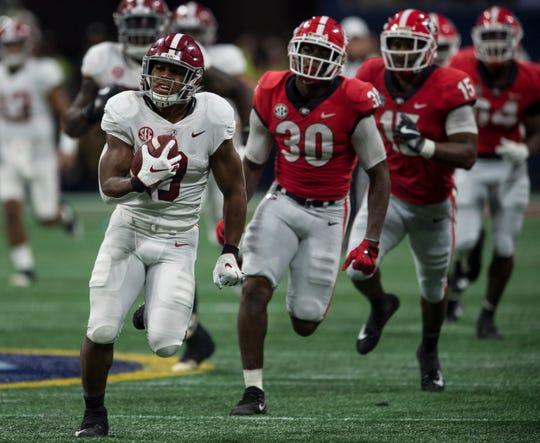 Alabama running back Josh Jacobs (8) breaks a big run during the SEC Championship game at Mercedes-Benz Stadium in Atlanta, Ga., on Saturday Dec. 1, 2018. Georgia leads Alabama 21-14 at halftime.