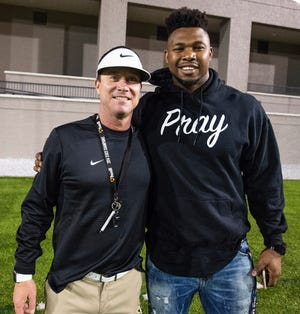 Auburn offensive lineman Prince Tega Wanogho greets his old coach Bobby Carr at the AISA All-Star Football Game at Cramton Bowl in Montgomery, Ala., on Friday November 30, 2018.