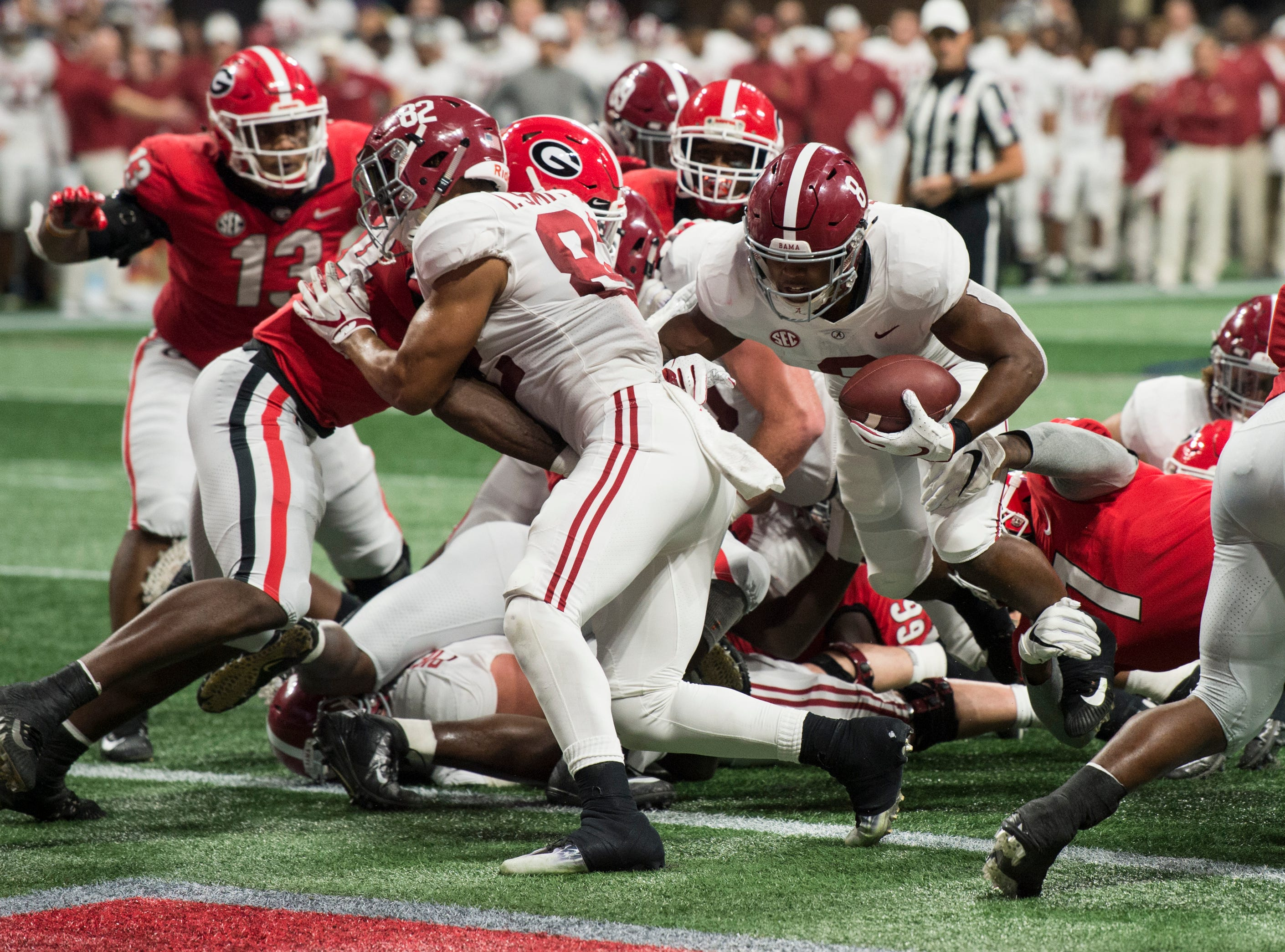 Alabama running back Josh Jacobs (8) runs into the end zone for a touchdown during the SEC Championship game at Mercedes-Benz Stadium in Atlanta, Ga., on Saturday Dec. 1, 2018. Georgia leads Alabama 21-14 at halftime.