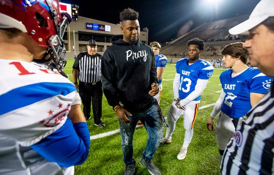 Former Edgewood player and current Auburn offensive lineman Prince Tega Wanogho flips the coin for the AISA All-Star Football Game at Cramton Bowl in Montgomery, Ala., on Friday November 30, 2018.
