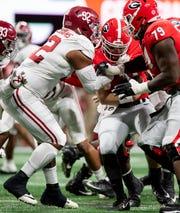 Alabama defensive lineman Quinnen Williams (92) sacks Georgia quarterback Jake Fromm (11) during first half action of the SEC Championship Game at Mercedes Benz Stadium in Atlanta, Ga., on Saturday December 1, 2018.