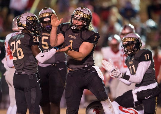 Wetumpka's Colton Adams (1) celebrates after making a stop in the backfield against Saraland at Hohenberg Field in Wetumpka, Ala., on Friday, Nov. 30, 2018. Wetumpka leads Saraland 14-8 at halftime.