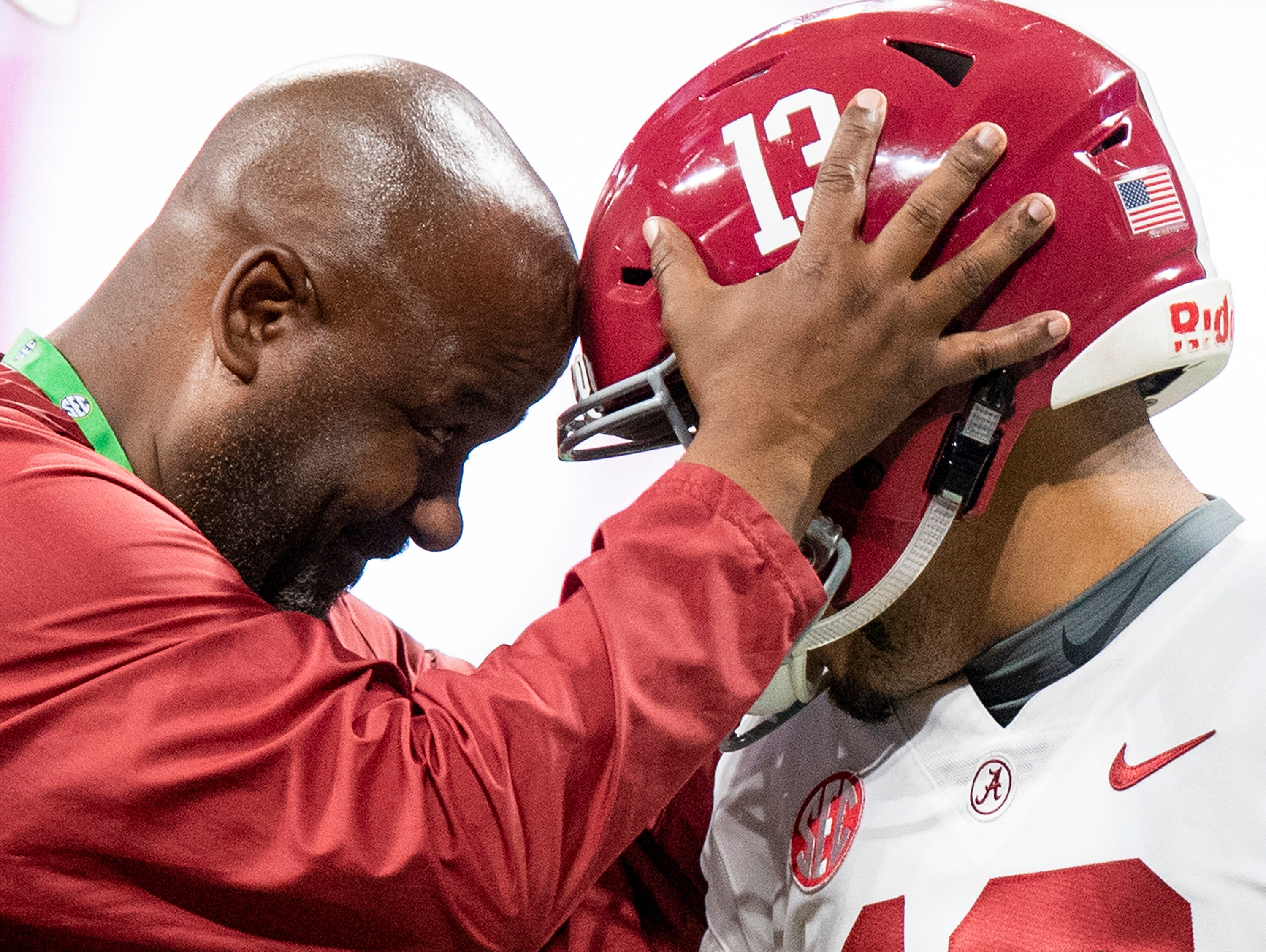 Alabama quarterback Tua Tagovailoa (13) and offensive coordinator Michael Locksley during warmups before the SEC Championship Game at Mercedes Benz Stadium in Atlanta, Ga., on Saturday December 1, 2018.