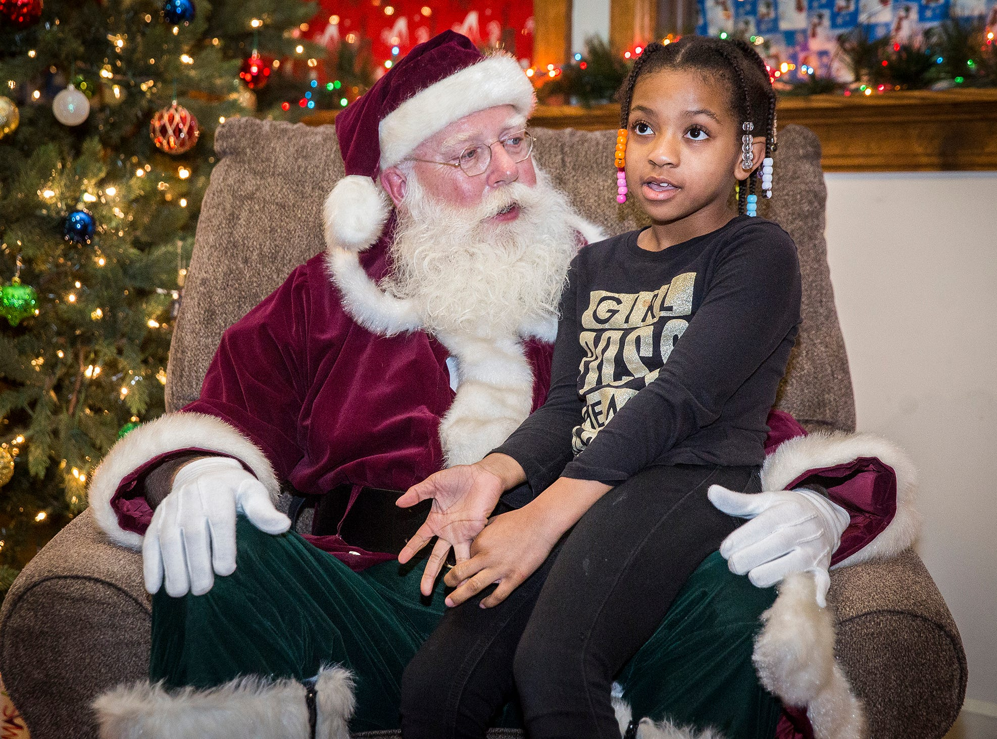 Hundreds of families stood in line to meet Santa at the Wysor Street Depot during the facility's An Old Fashioned Christmas event Friday evening. Attendees enjoyed hot coco and Christmas-themed stories before they visited Santa and received a free gift.