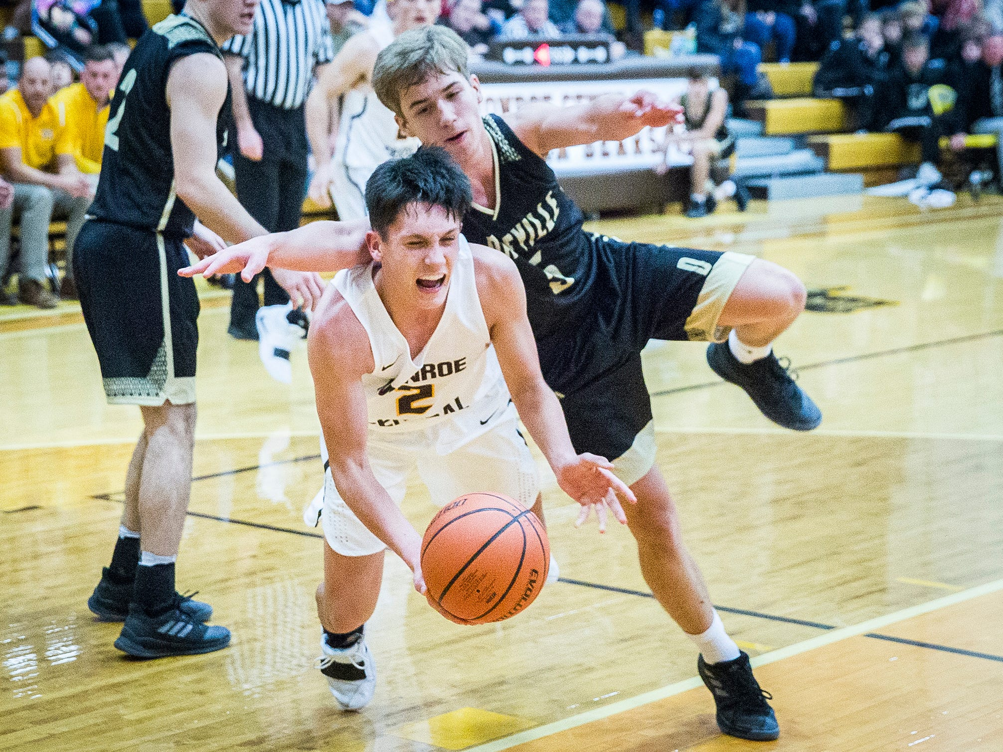 Monroe Central's Jackson Ullom is fouled by Daleville's Connor Fleming during their game at Monroe Central High School Friday, Nov. 30, 2018.