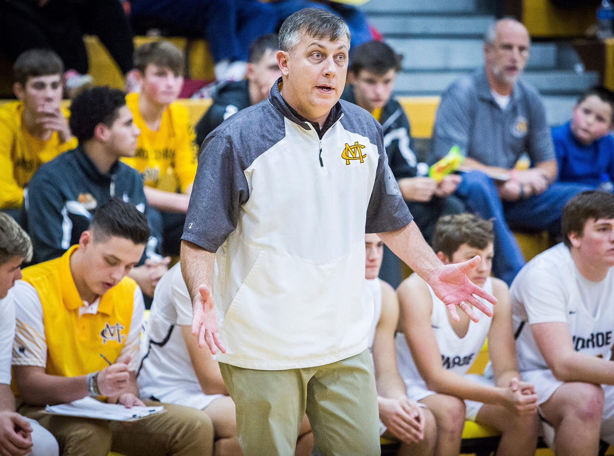 Monroe Central coach Justin Ullom instructs his team in a win over Daleville.