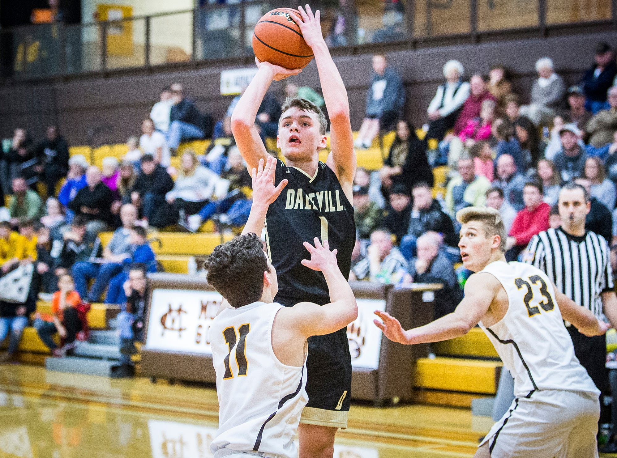 Daleville's Tim Arnold shoots past Monroe Central's defense during their game at Monroe Central High School Friday, Nov. 30, 2018.