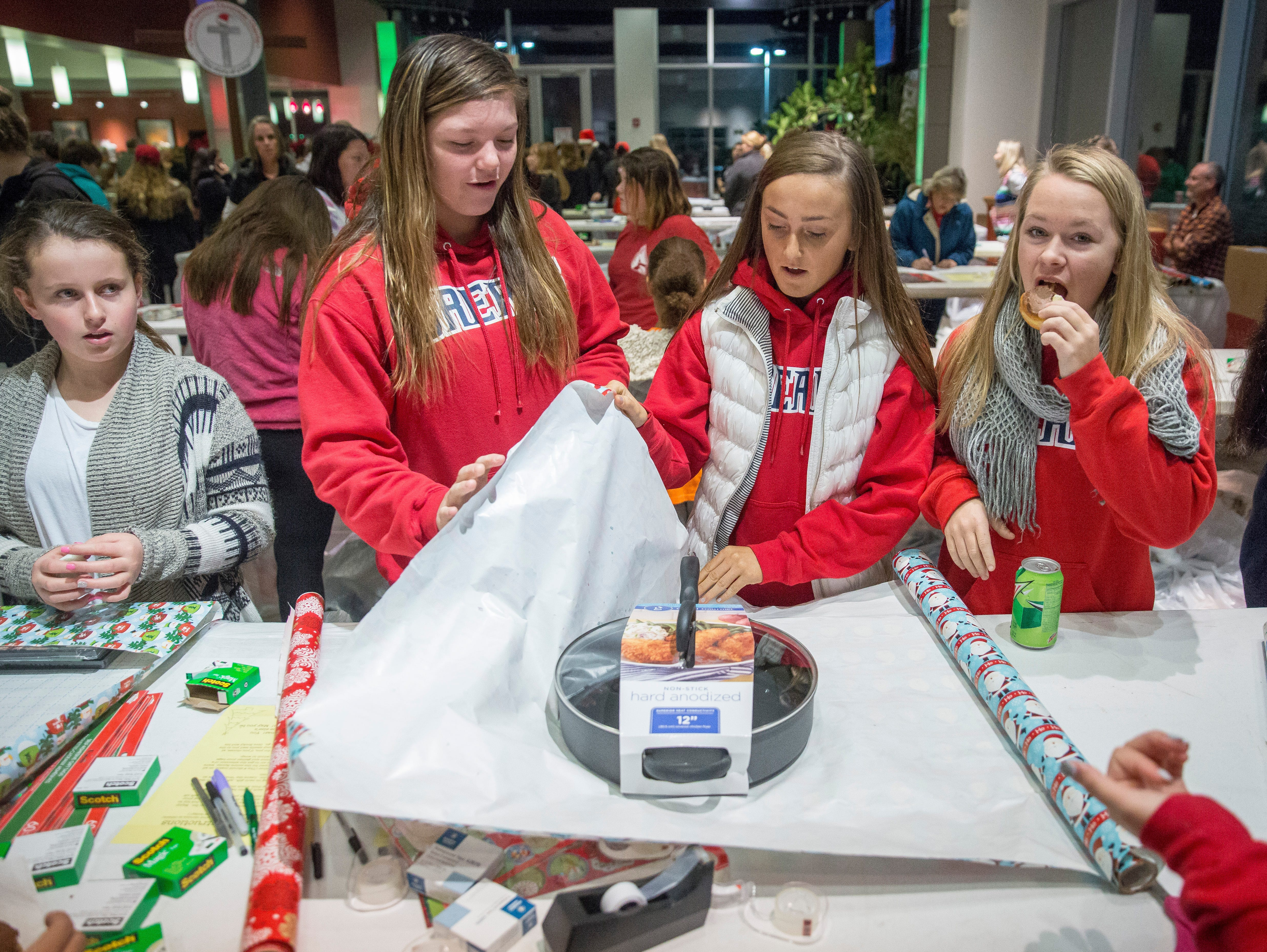 Hundreds of Volunteers gather at Toyota of Muncie to wrap and deliver presents Saturday during the Secret Families Christmas Charity event. Three groups worked to buy the gifts, wrap them and deliver them.
